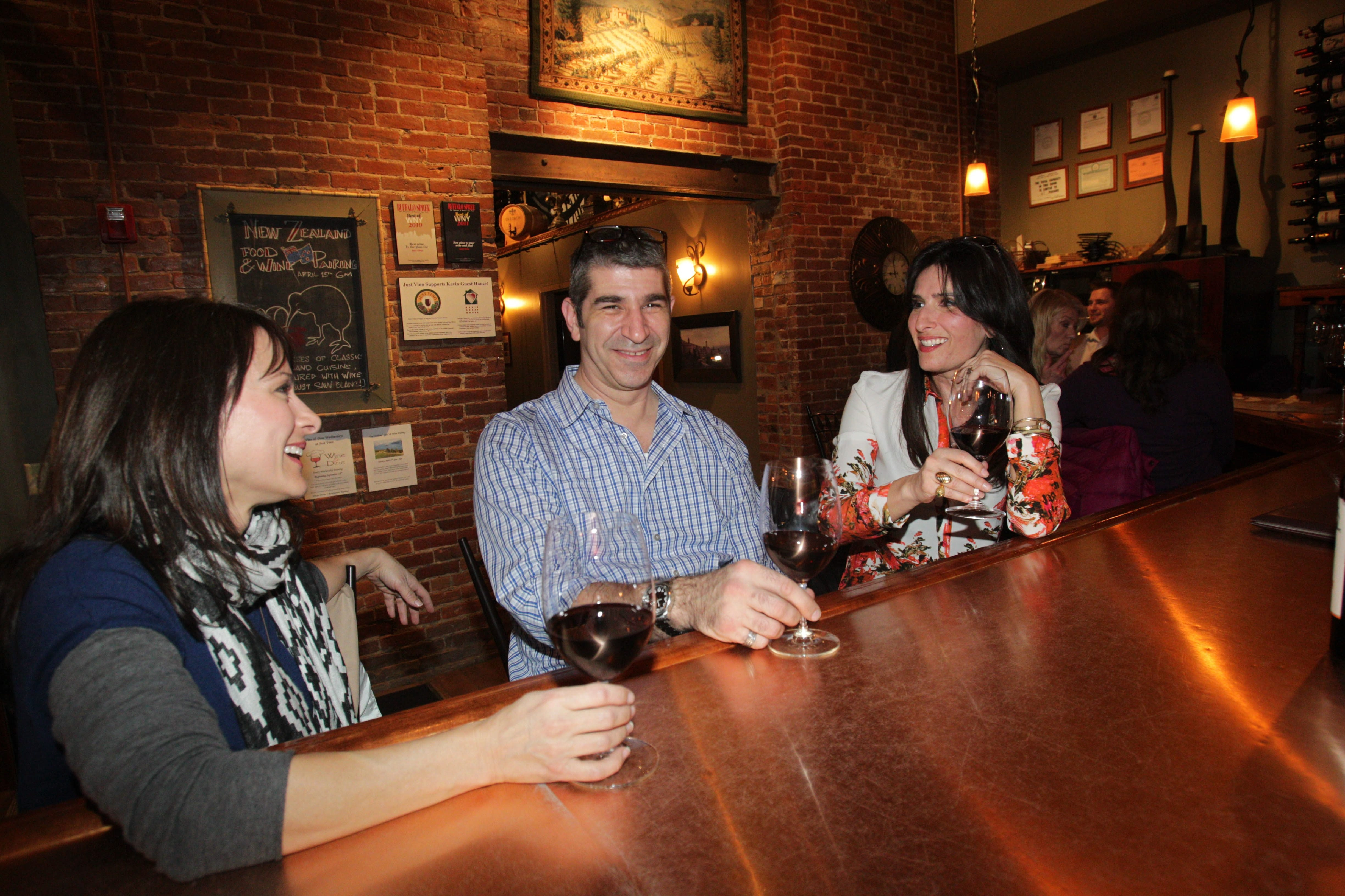 Rhea Anna of Buffalo, Doug Levere of Amherst and Leah Glickman of Buffalo enjoy glasses of wine at Just Vino.