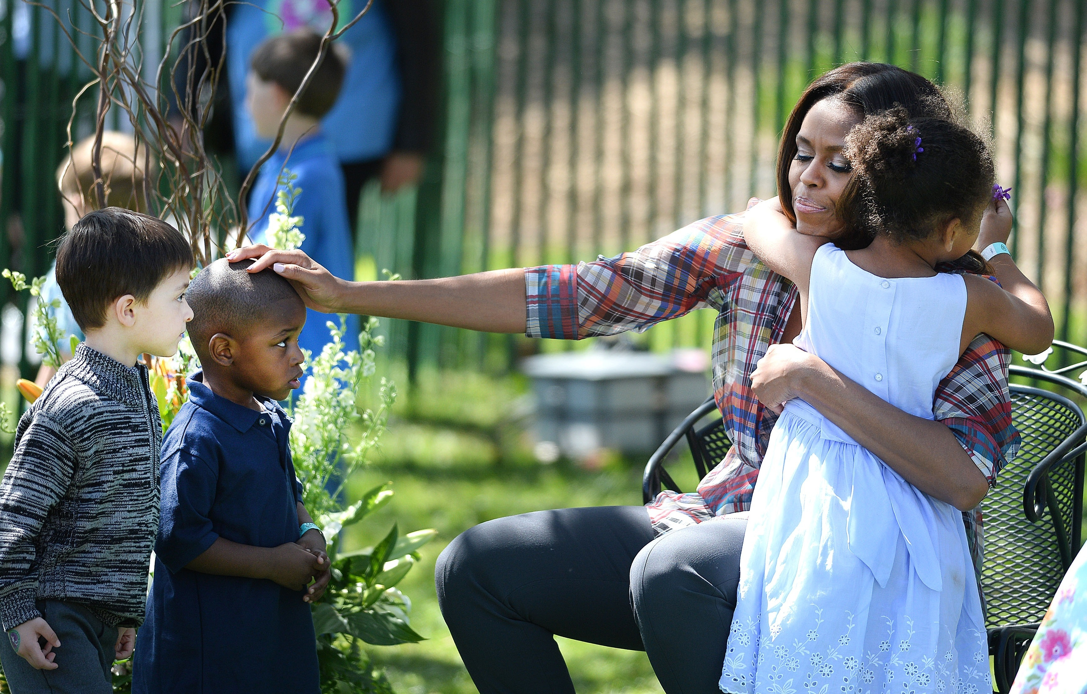 First lady Michelle Obama greets kids after reading them a story during the annual White House Easter Egg Roll.