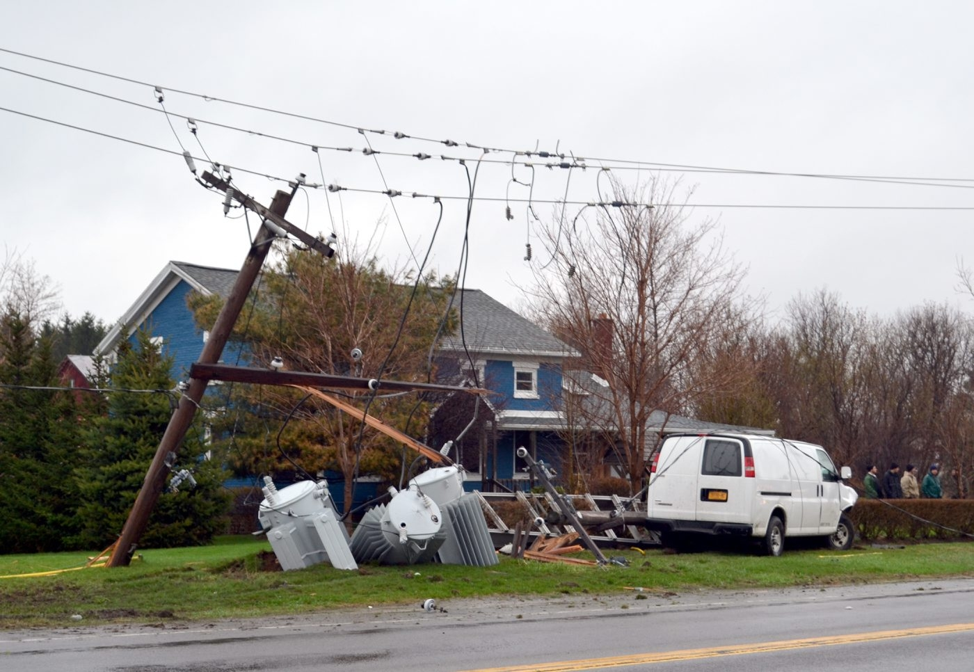 This van driven Robert Domagala drove off the road and struck two power poles at 3511 Ridge Road/Route 104, just past Church Road, earlier this morning.