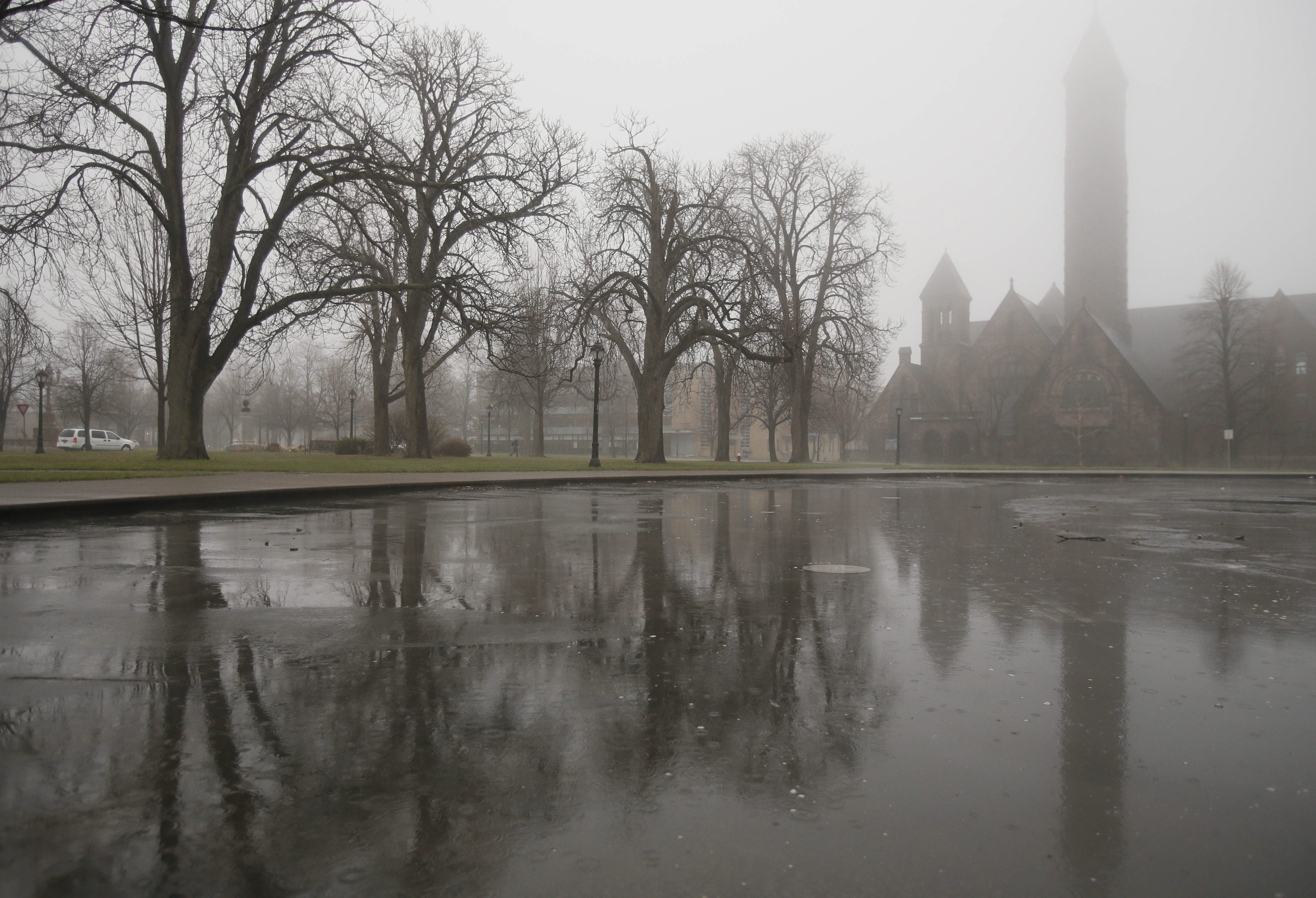 Morning fog obscures the steeple of the First Presbyterian Church in Symphony Circle, Tuesday, April 22, 2014.  (Derek Gee/Buffalo News)