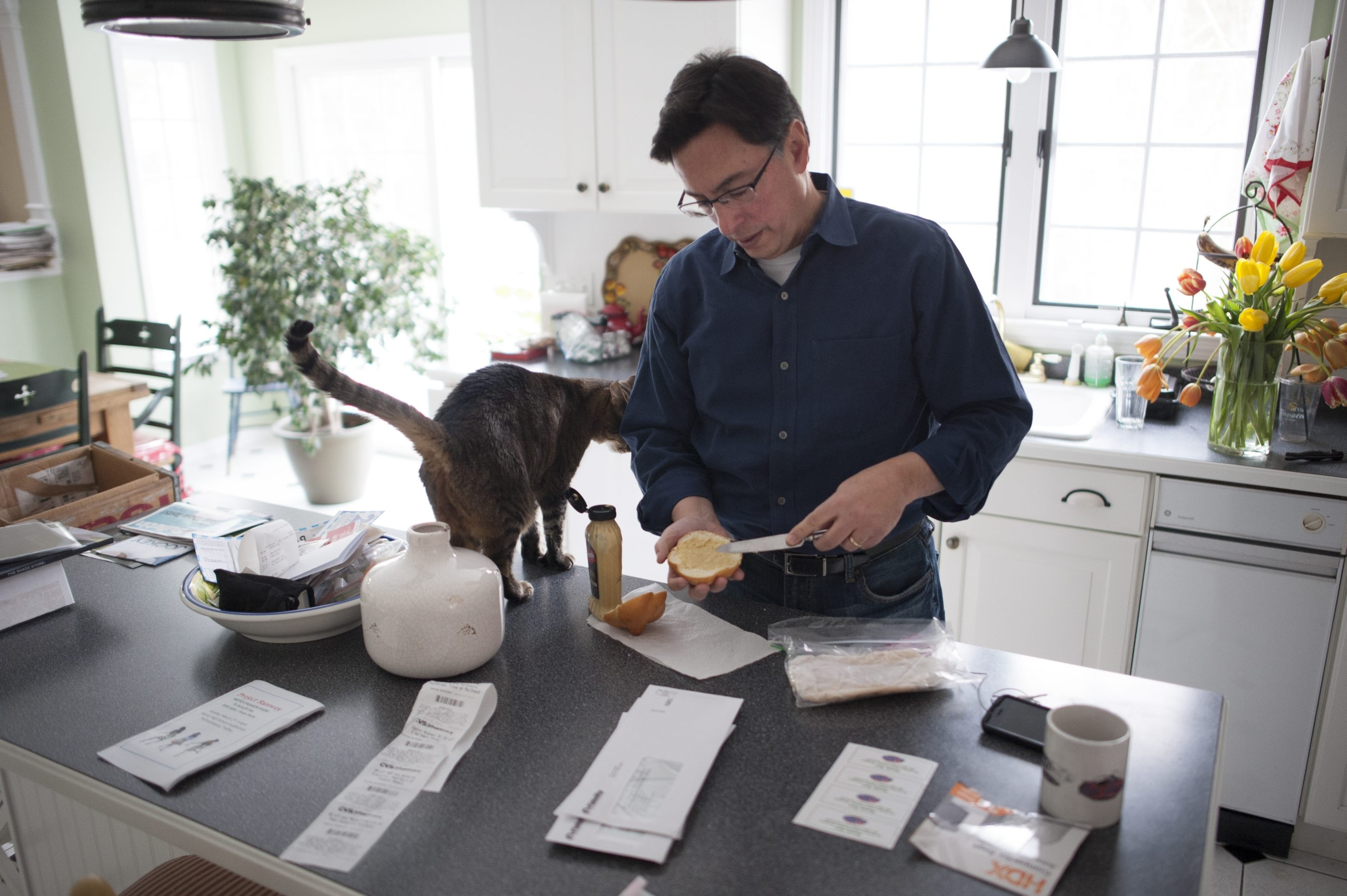 Abe Gorelick, an experienced marketing professional, prepares lunch before starting his shift as a part-time taxi driver in Natick, Mass. Uncertainty about the future for him and others racked by the recession nationwide remains a pressing economic question.
