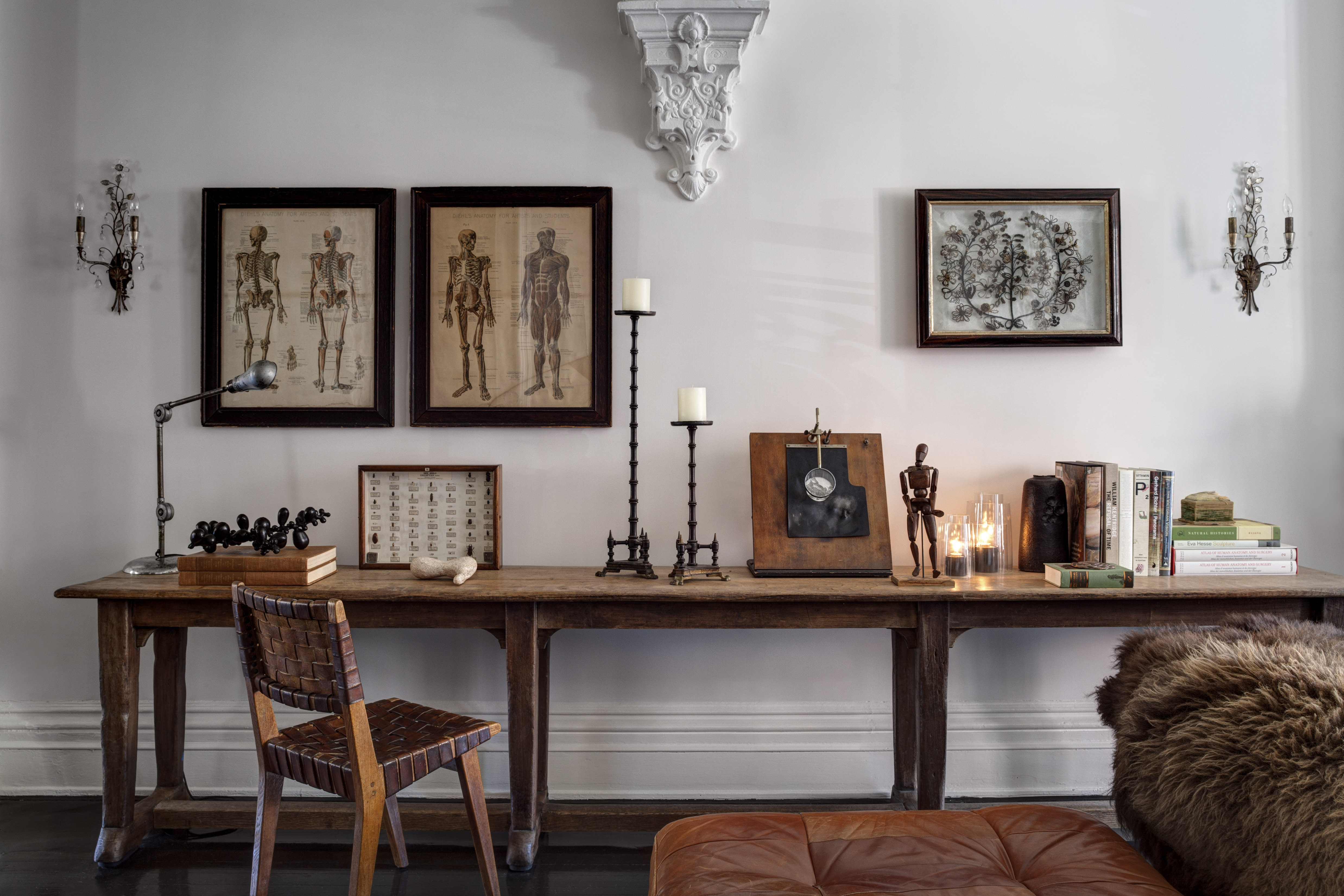 Framed prints of skeletons and a mourning wreath hang over a Belgian console table in the home of Tracy Martin, proprietor of the soon-to-open Morbid Anatomy Museum in Brooklyn.