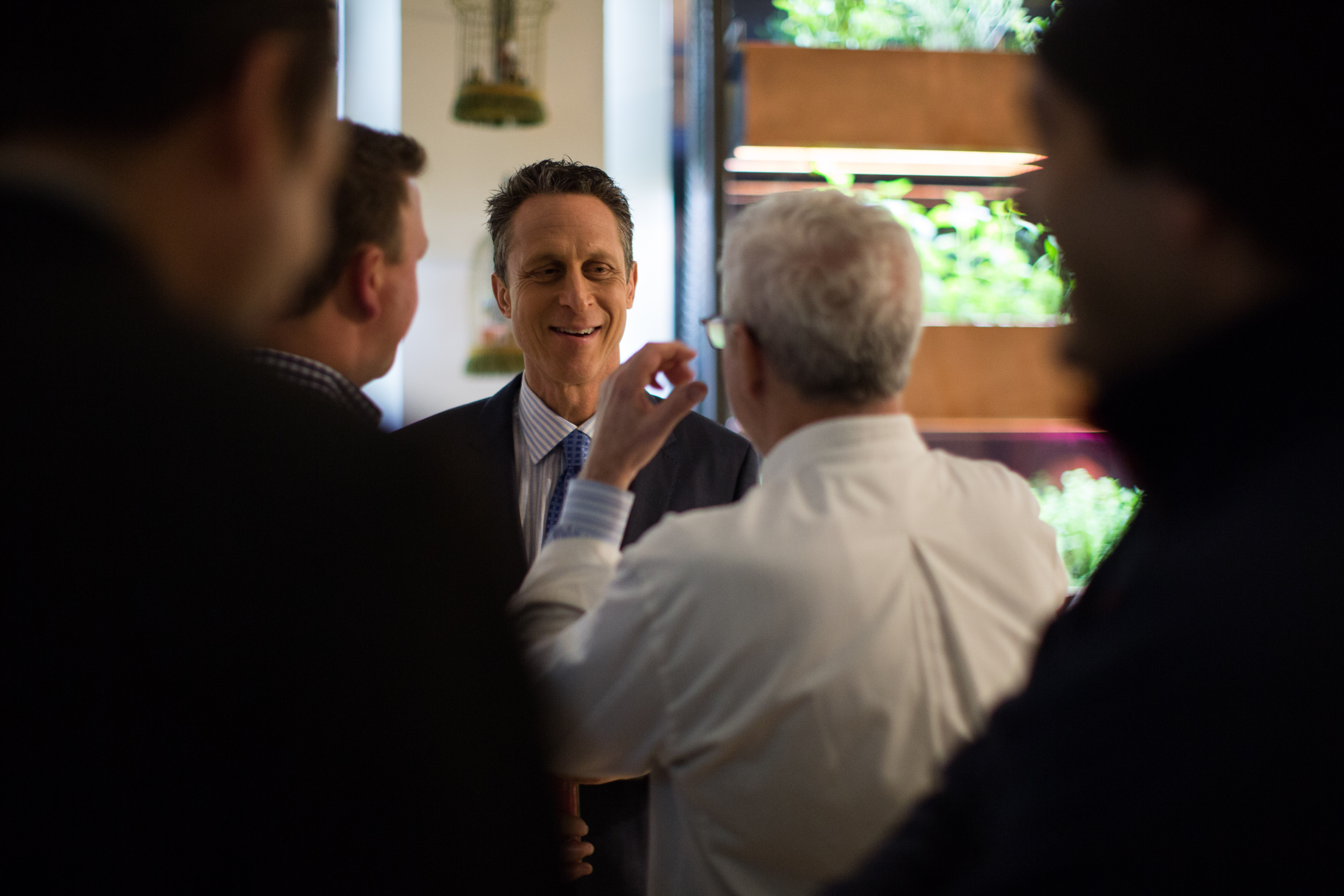 "Dr. Mark Hyman meets guests at a party for his new book, ""The Blood Sugar Solution: 10-Day Detox Diet,"" earlier this year. Hyman embraces a wellness philosophy called ""functional medicine,"" which addresses the root causes of chronic diseases though dietary and lifestyle changes."