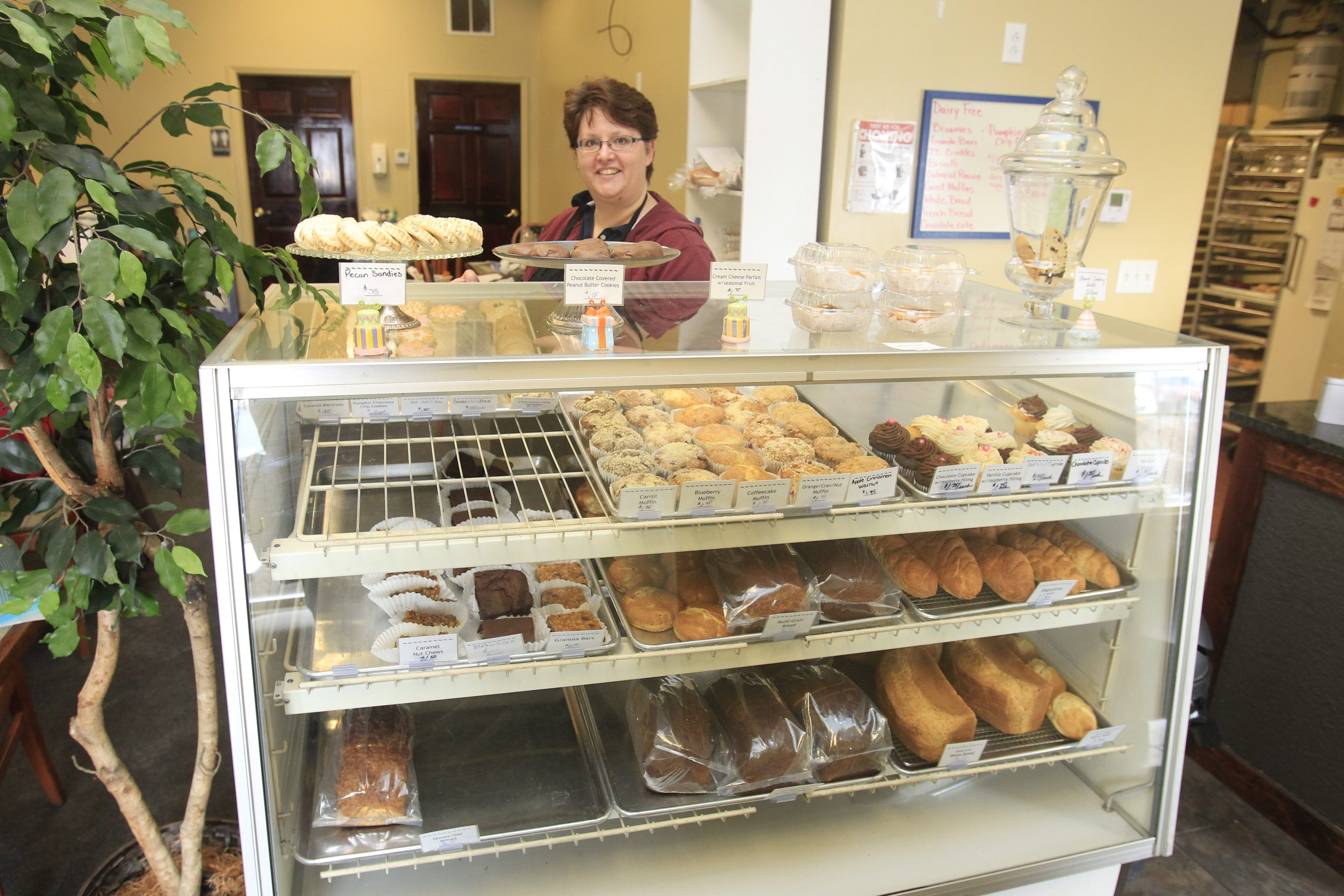 Lisa Jermyn stands behind a well-stocked display case in her specialty bakery, A Better Way. Jermyn quit her job as a teacher to open A Better Way, which sells gluten-free breads and baked goods.