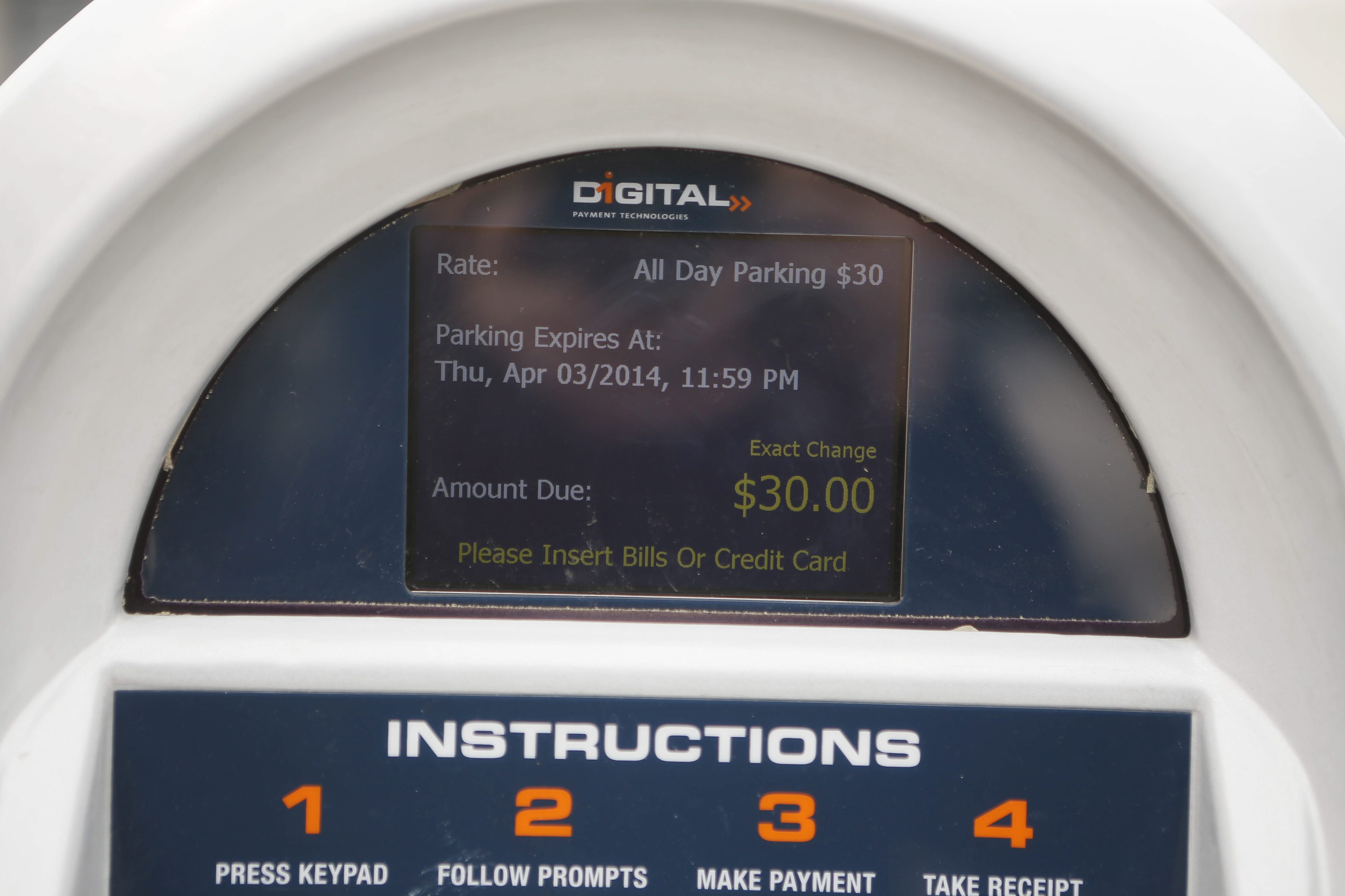 The meter in the Pay2Park lot on Huron and Franklin streets on Thursday indicates the parking fee for the day is $30.