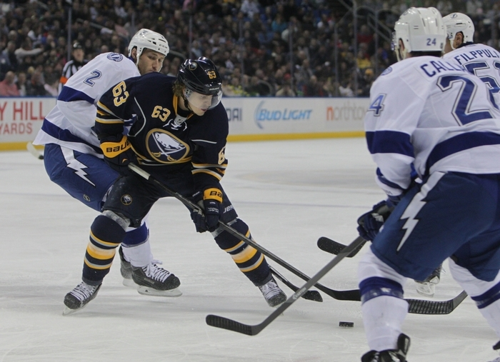 The Buffalo Sabres played Tampa Bay Lightning at First Niagara Center, Saturday, March 29, 2014. This is first period play.  Tyler Ennis fights for the puck. (Photo by Sharon Cantillon/Buffalo News)
