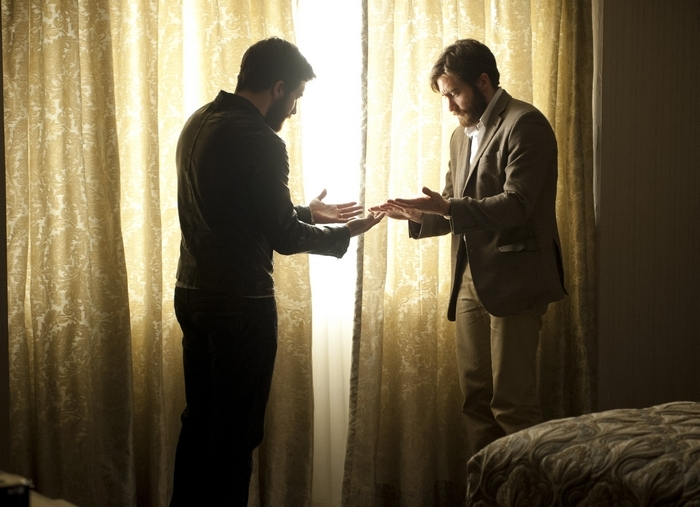Jake Gyllenhaal meets his double in a scene from the movie 'Enemy.'