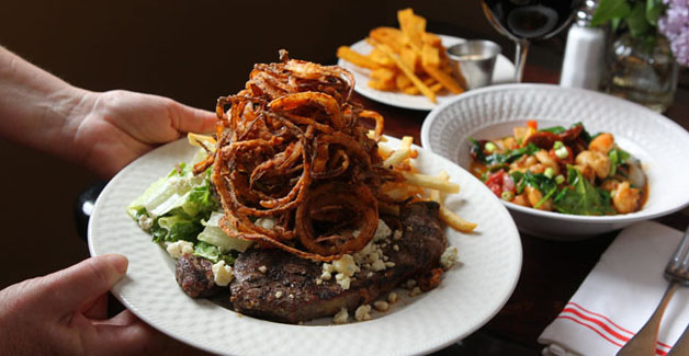 Steak frites, polenta fries, and shrimp and grits at The Phoenix.  (Mark Mulville/Buffalo News)