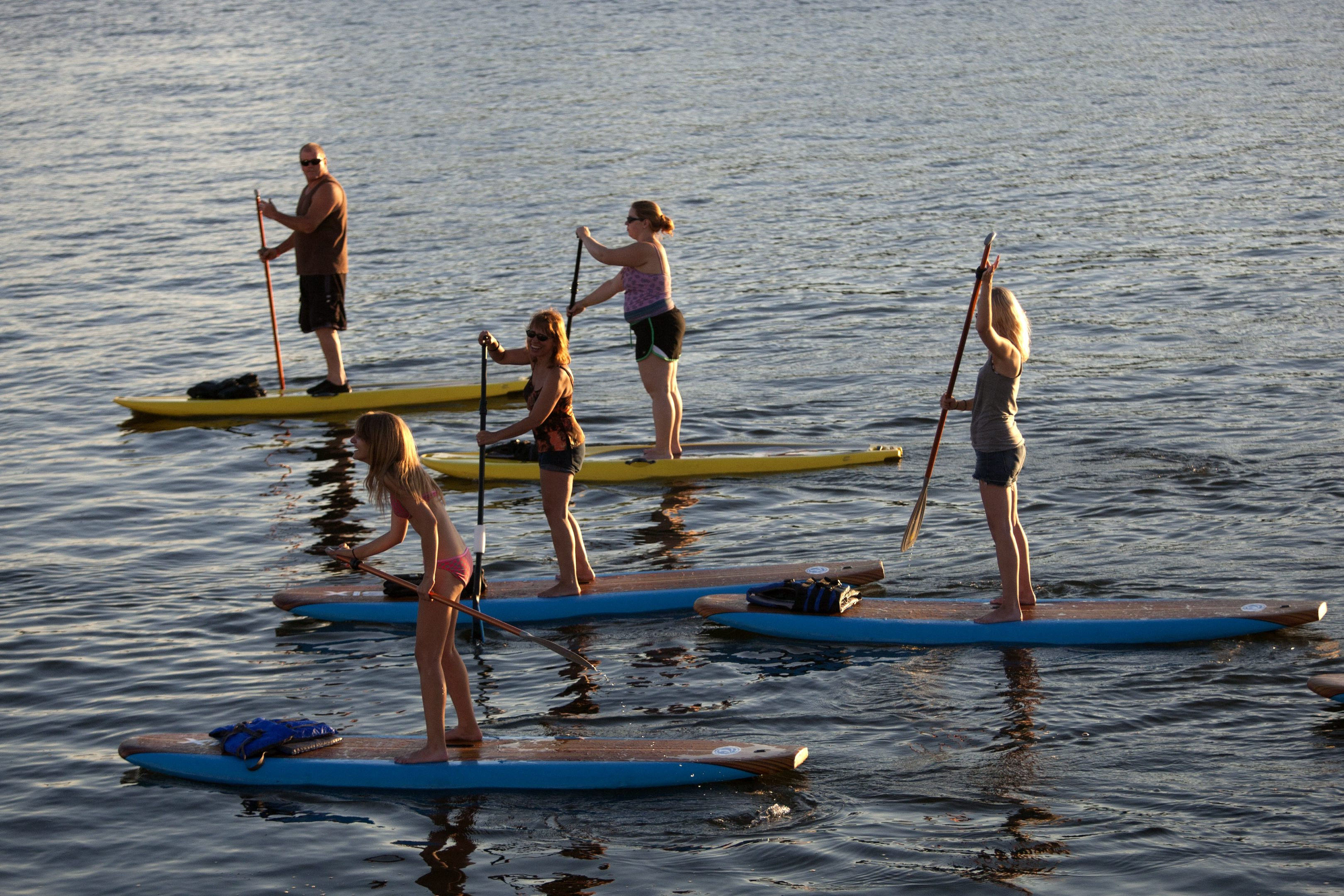 Paddleboarders make their way along Buffalo's waterfront, one of the earliest signs of activity resulted from Great Lakes restoration efforts. (News file photo)