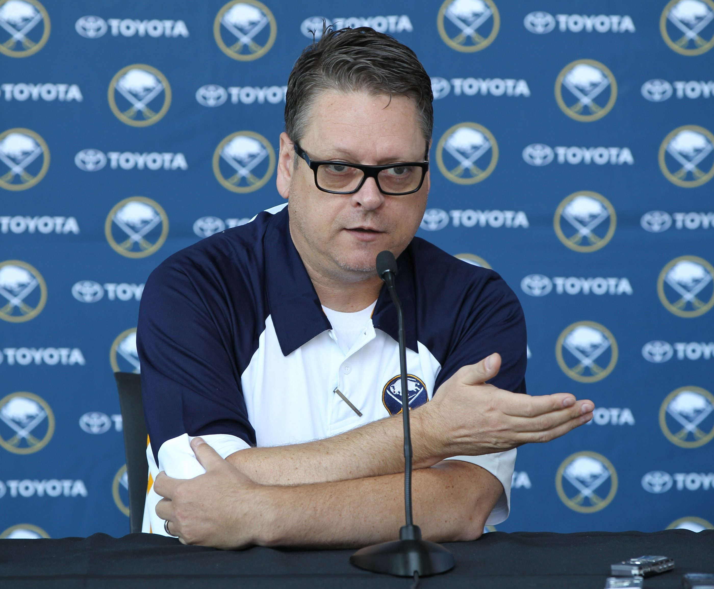 Tim Murray speaks to the press for the first time after the NHL draft a First Niagara Center Monday, June 30, 2014.  (James P. McCoy/ Buffalo News)