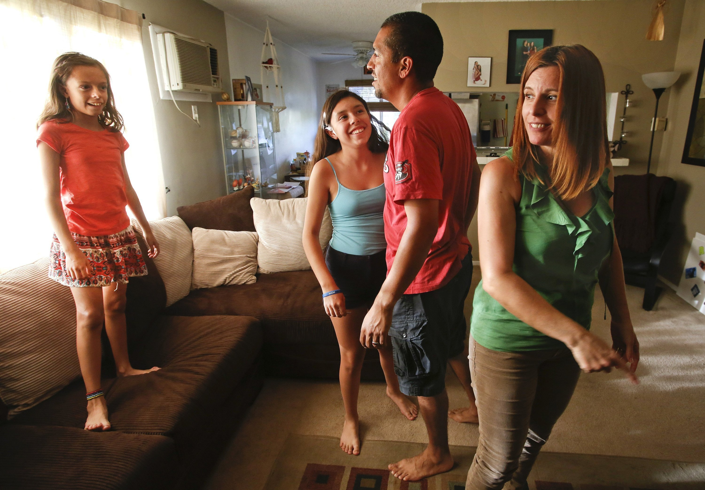 The Macias family -- Jenesee, 10, left; Sabreena, 12; Victor, 40, and Shannon, 44 -- rent an apartment in Eagle Rock, a Los Angeles neighborhood they love. Victor and Shannon would like to buy a house there, but a financial planner advises that they should wait until they have more savings. (Mel Melcon/Los Angeles Times/MCT)