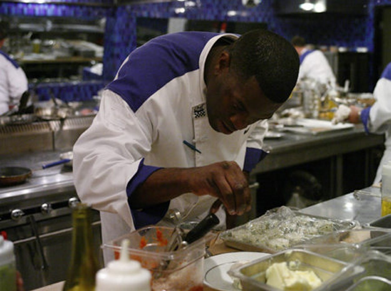 Celebrity chef Bobby Anderson trains inner-city youth about cooking.