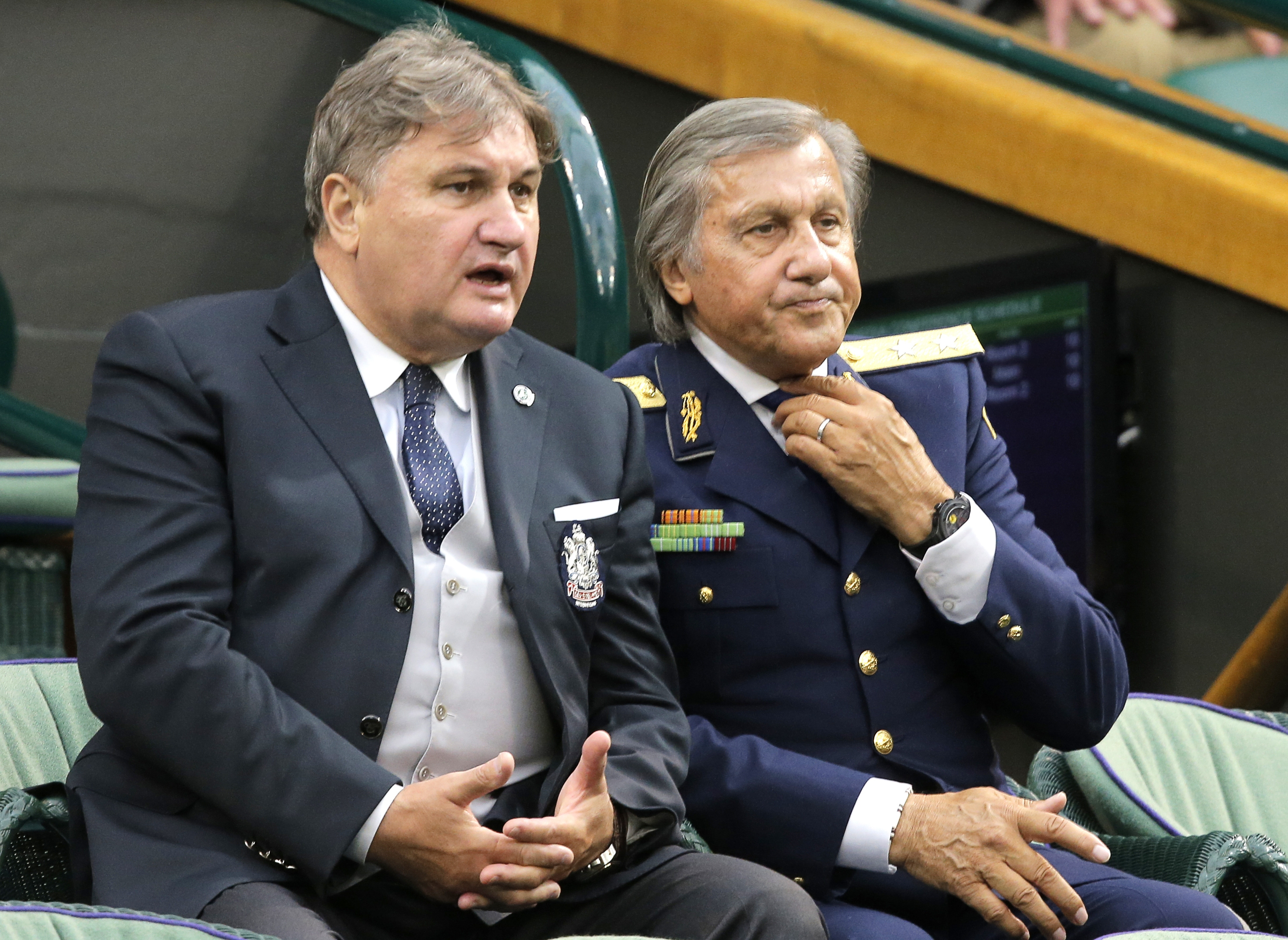 Wimbledon wear: Tennis great Ilie Nastase donned the uniform of a Romanian major general while attending the Tennis Championships in Wimbledon, England, on Monday.