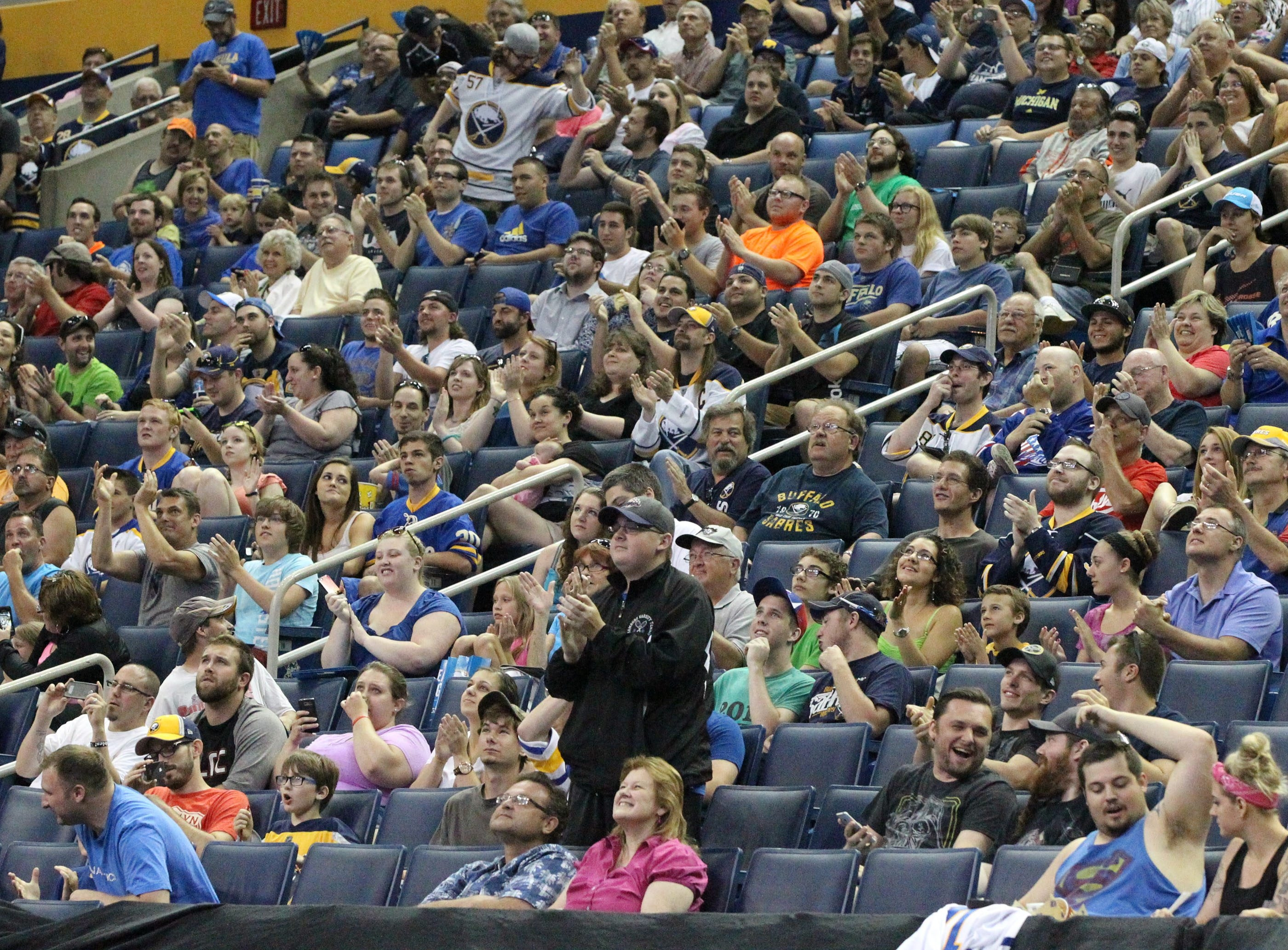Sabres fans clap and cheer at the announcement of the Sabres first round pick at the NHL Draft at the First Niagara Center in Buffalo,NY on Friday, June 27, 2014.  (James P. McCoy/ Buffalo News)