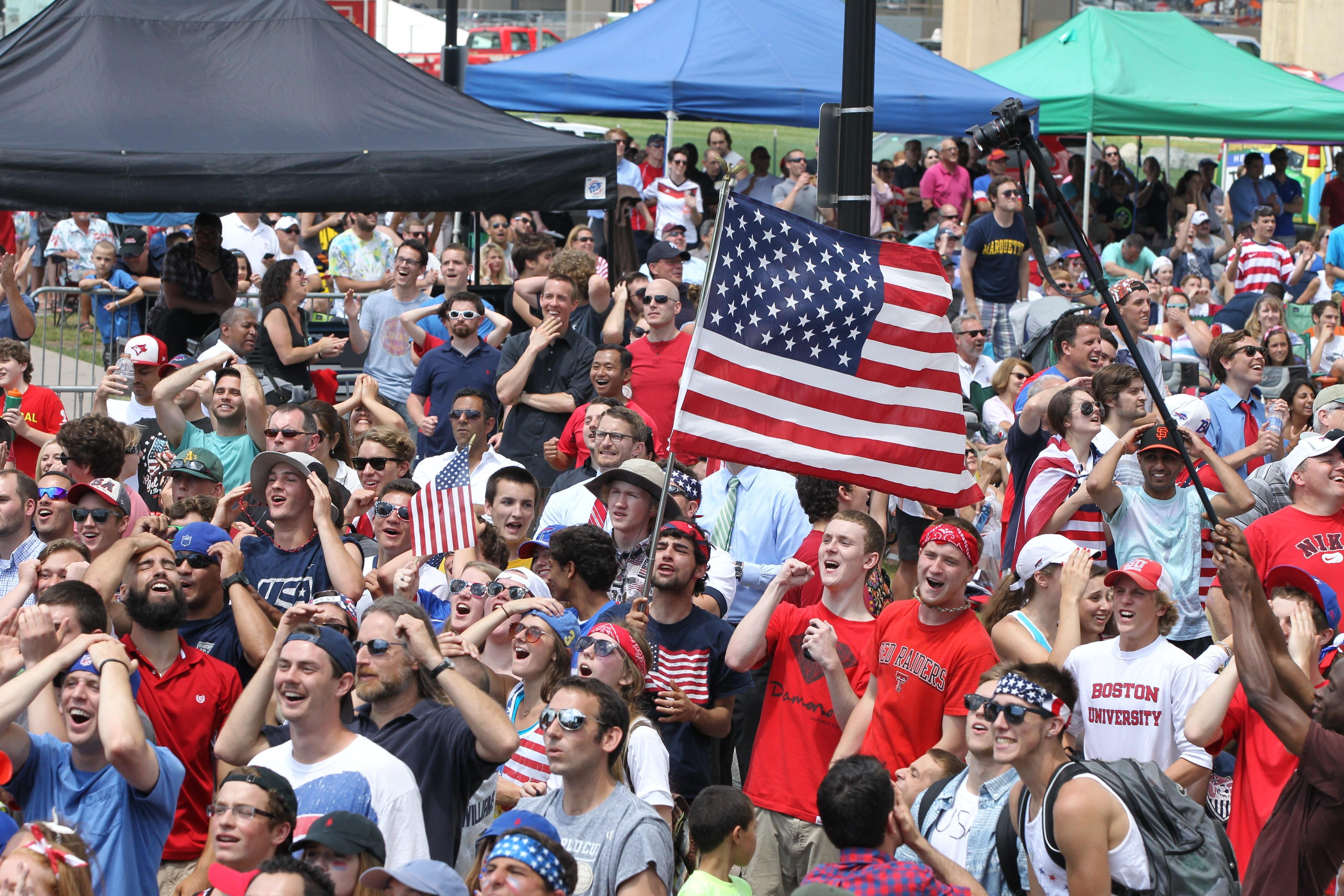 Several thousand fans watch the U.S.-Germany game on a large-screen TV at Canalside in Buffalo on Thursday. Despite losing 1-0, the U.S. team advanced to the Round of 16 with a superior goal difference over Portugal.