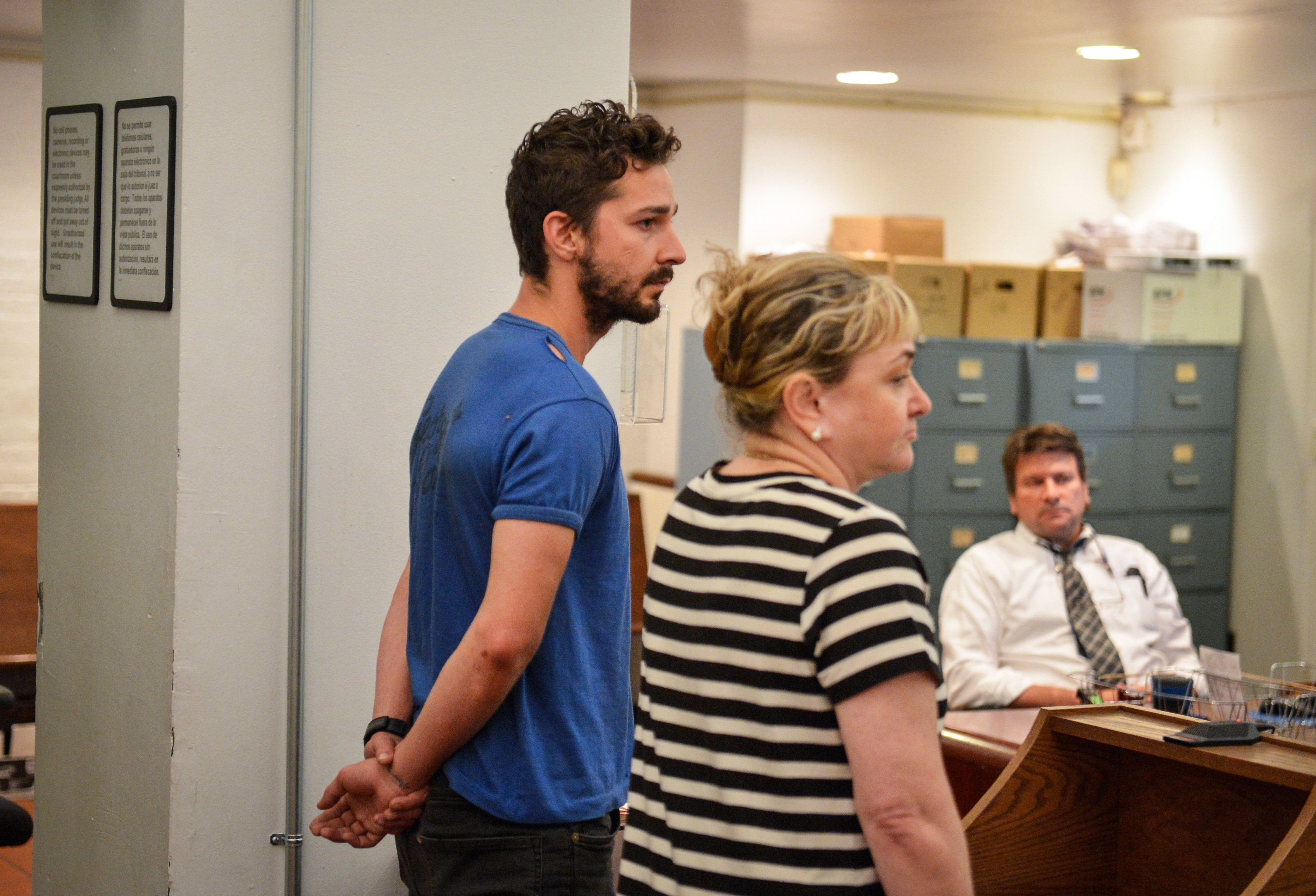 Actor Shia LaBeouf, left, represented by a Legal Aid attorney, is arraigned on disorderly conduct charges in Midtown Community Court in New York on Friday.