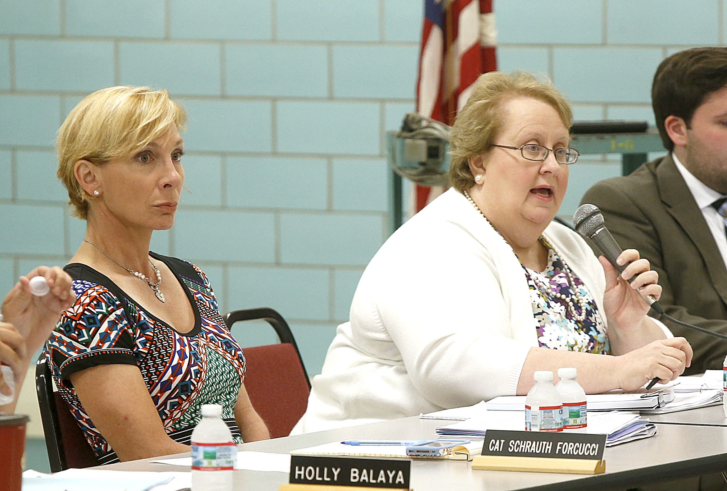 Catherine Schrauth Forcucci, left, with her attorney, Margaret Murphy, while questioning Superintendent Richard Jetter at the public hearing Wednesday in Armor Elementary School.