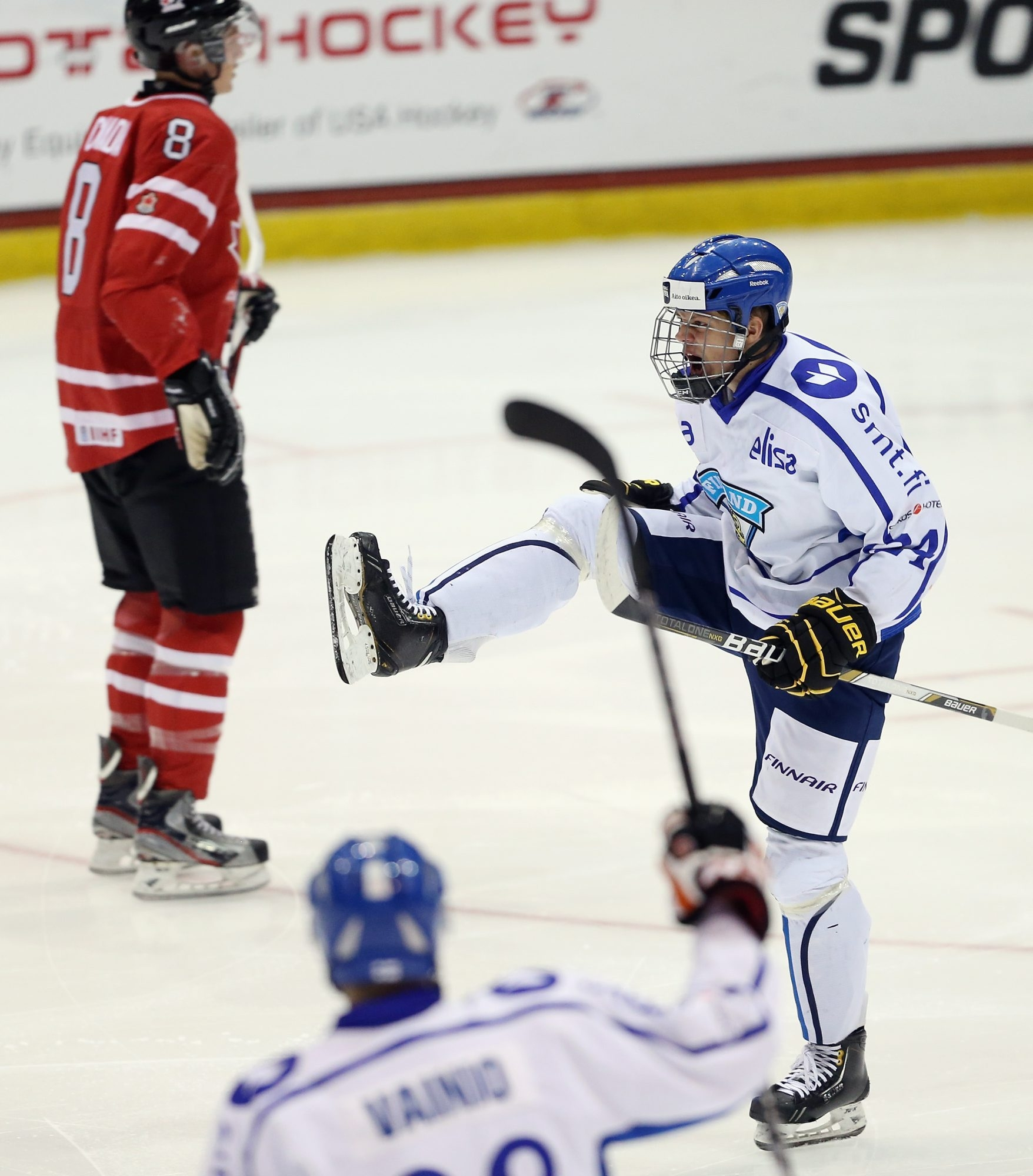 LAKE PLACID, NY - AUGUST 07: Kasperi Kapanen #24 of Team Finland celebrates his goal 51 seconds into the first period against Team Canada during the 2013 USA Hockey Junior Evaluation Camp at the Lake Placid Olympic Center on August 7, 2013 in Lake Placid, New York.  (Photo by Bruce Bennett/Getty Images)
