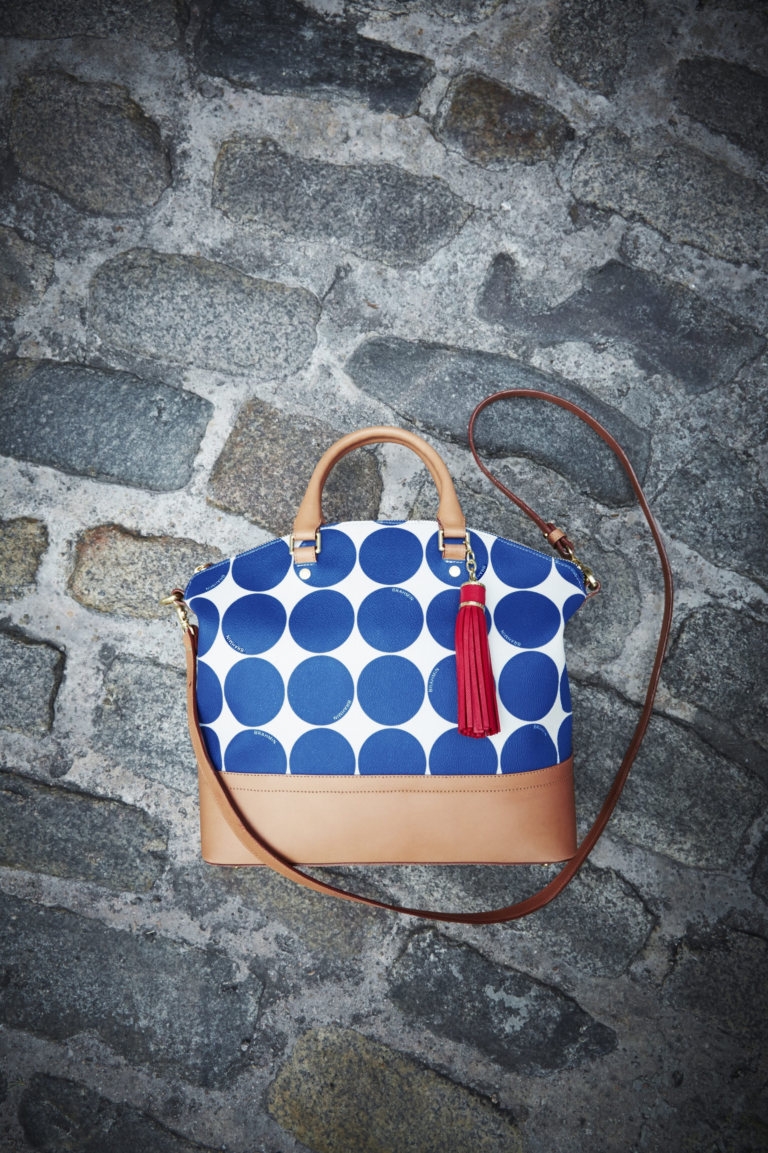 Tired of polka dots? Never. This perky pattern looks fresh season after season. The Brahmin satchel, above, is from www.macys.com.