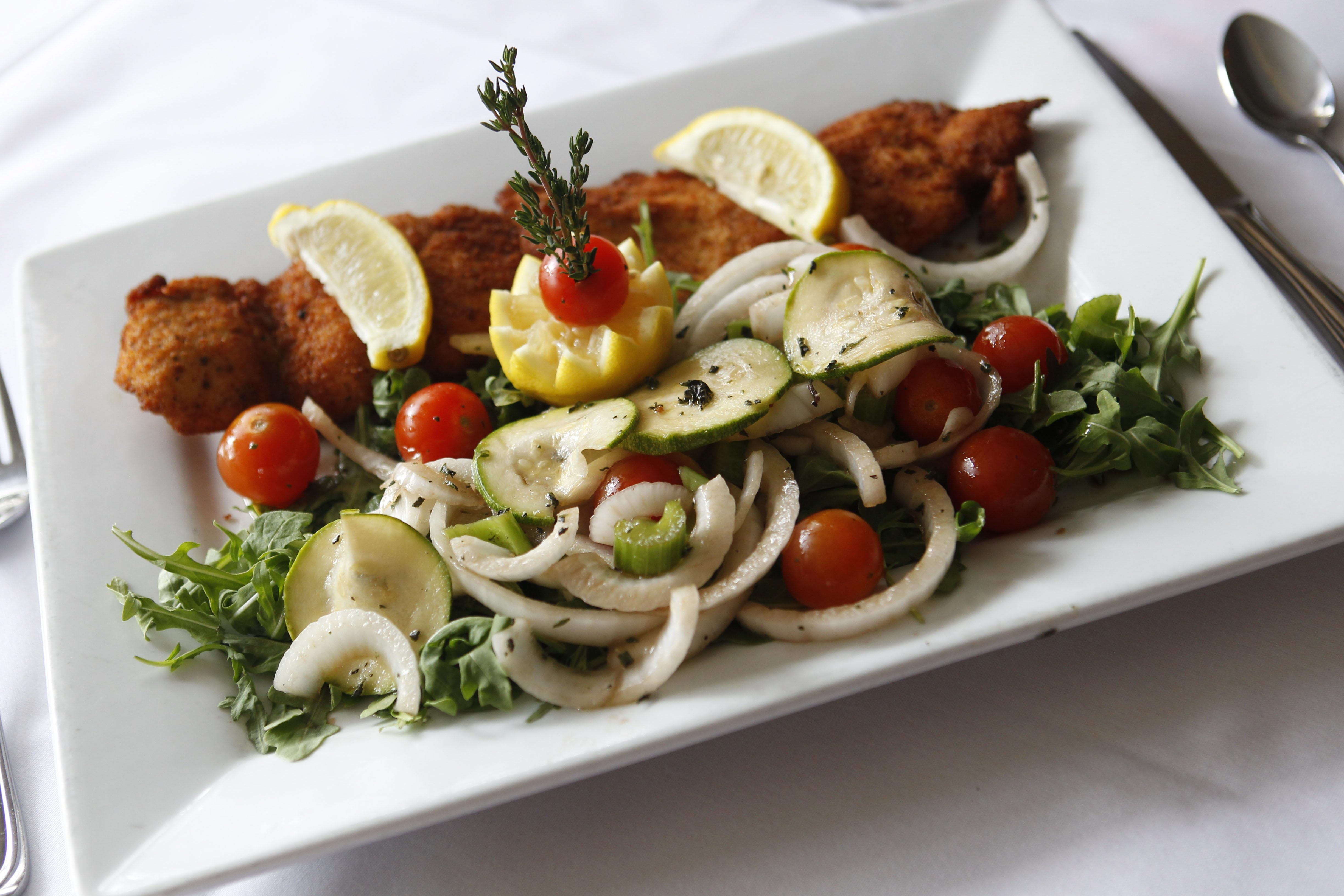 Breaded chicken cutlet with arugula, julienne Spanish onion, celery, cucumbers and cherry tomato with balsamic olive oil vinaigrette.