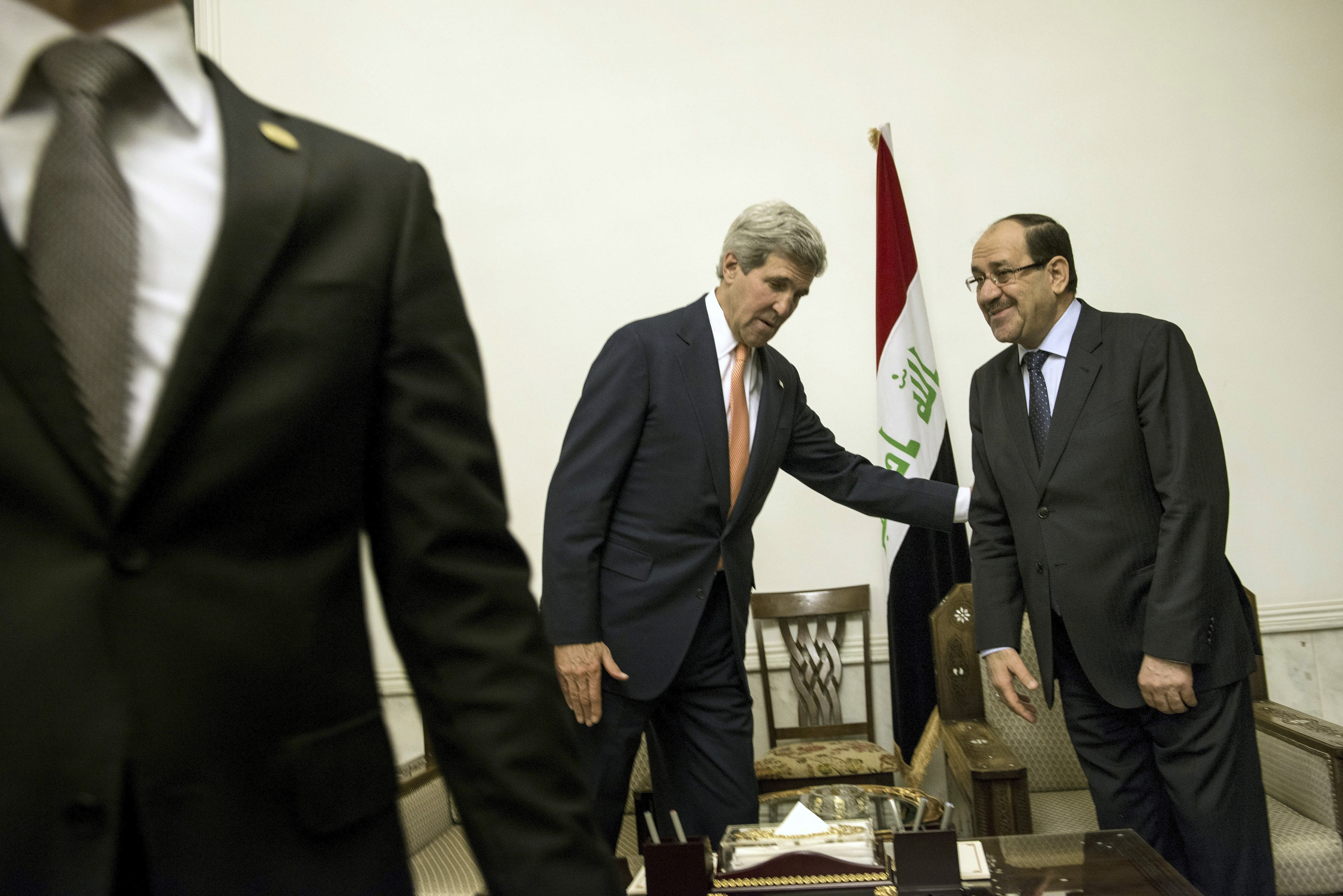 U.S. Secretary of State John Kerry meets with Iraqi Prime Minister Nouri al-Maliki on Monday. Kerry wanted to urge the Iraqis to form a new, inclusive government.