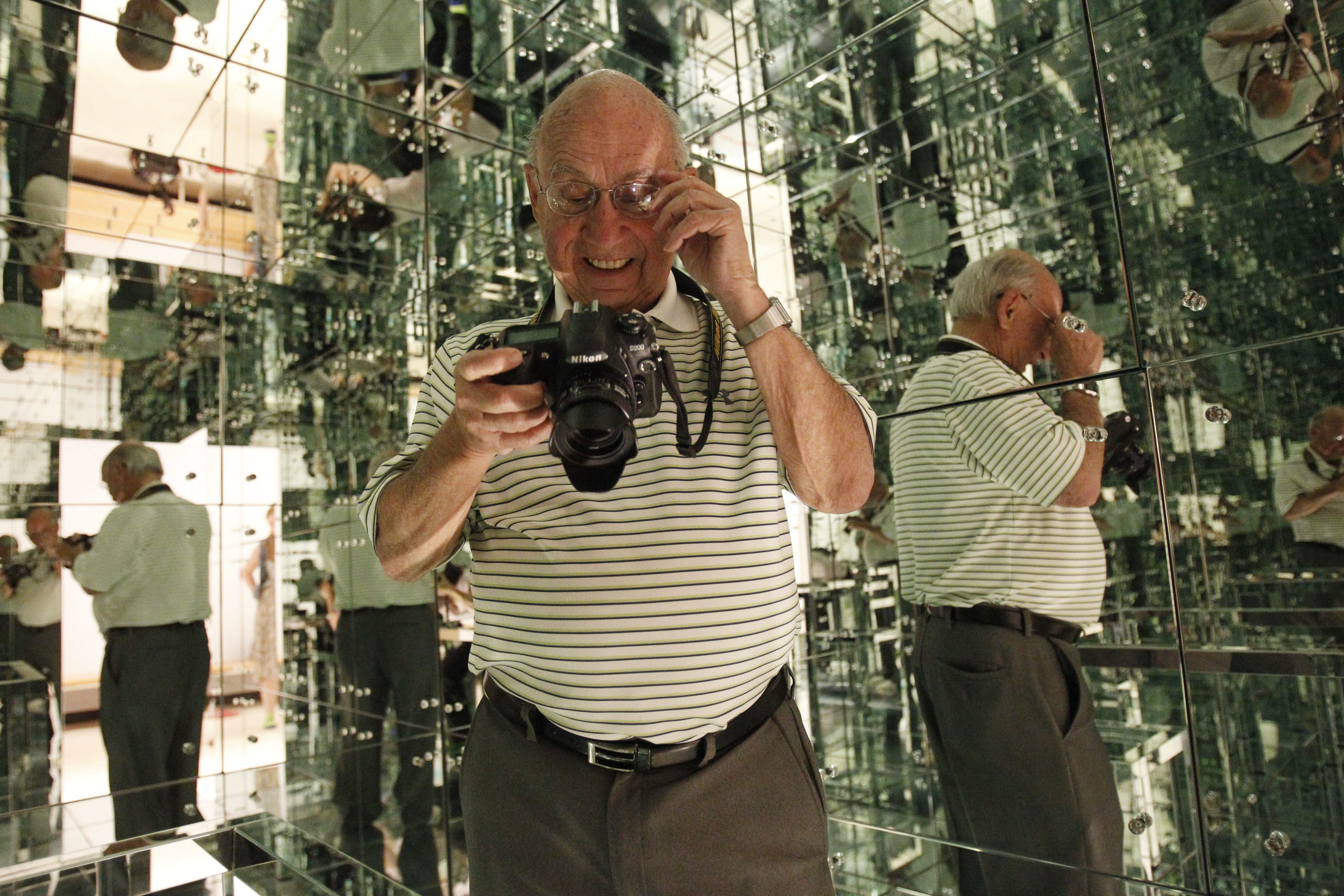 "The ""Mirrored Room"" is back on display at Albright-Knox Art Gallery after being gone for many years. Ron Moscati, a former Buffalo News photographer, returned Friday to re-create the photo he took for the Courier-Express in 1966."
