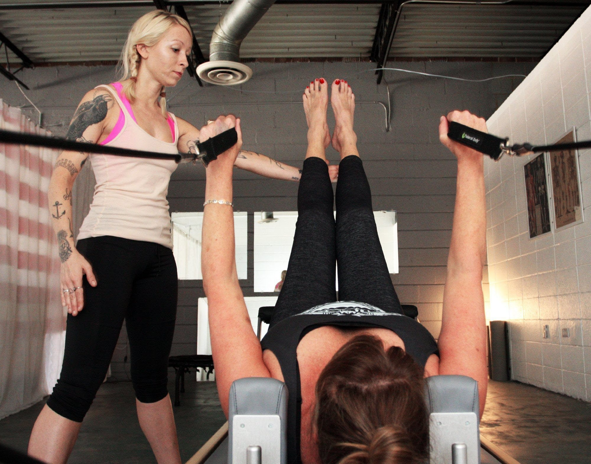 Freelance personal trainer Stella Wingfield Cook, who is part of an expanding freelance economy, guides Marcia Brooks through a workout.