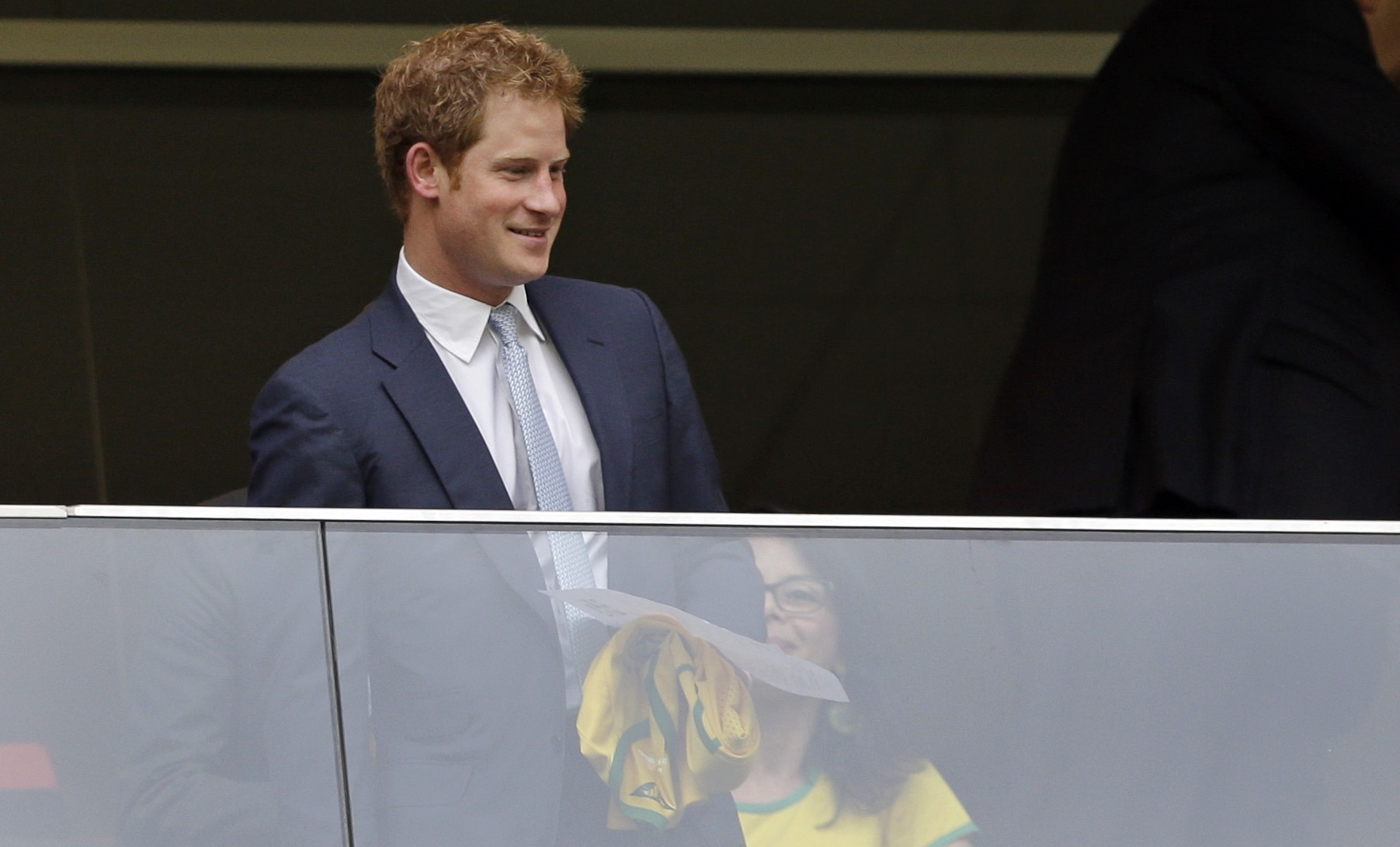 World Cup fever: Britain's Prince Harry holds a Brazil shirt as he arrives for the group A World Cup soccer match between Cameroon and Brazil in Brasilia on Monday.