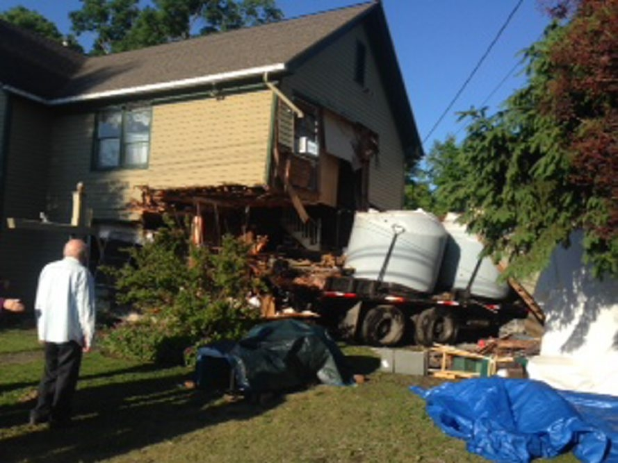 Truck carrying liquid fertilizer struck a house in Strykersville this morning. (Photo credit: Wyoming County Sheriff's Office)