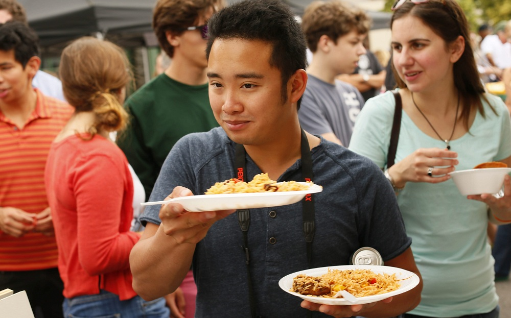 UB student Joey Lee of Putnam Valley with dishes from Lucy Ethiopian at the Taste of Diversity on Grant Street, Saturday, June 29, 2013.  (Derek Gee/Buffalo News)