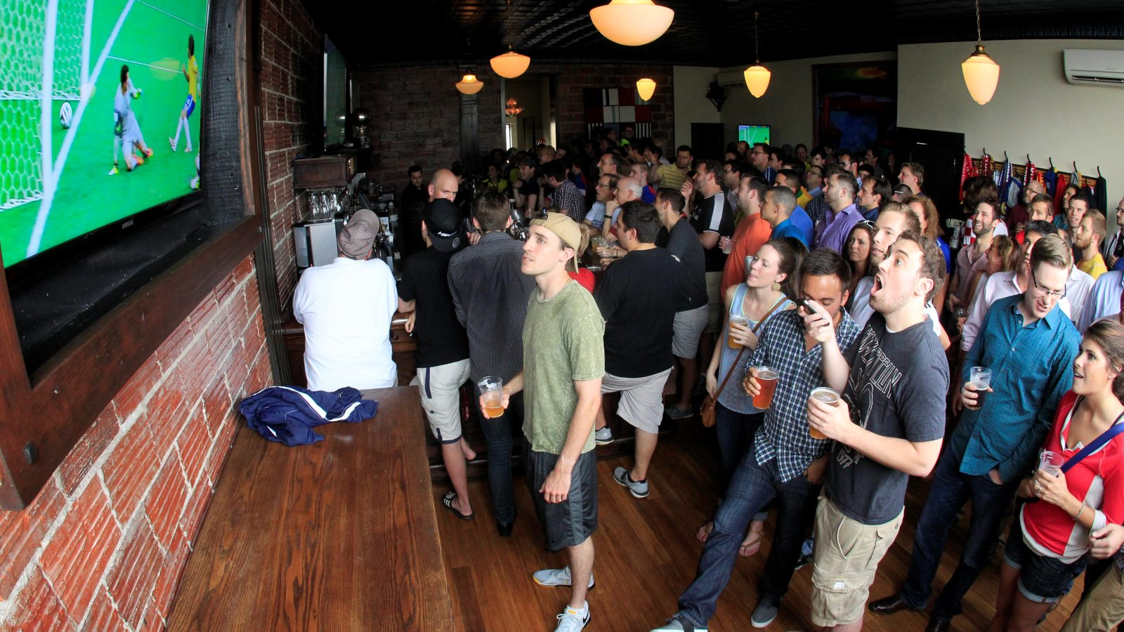 Tough call: Working hard at the office or having a drink at Mes Que with the game on? (Harry Scull Jr./Buffalo News)