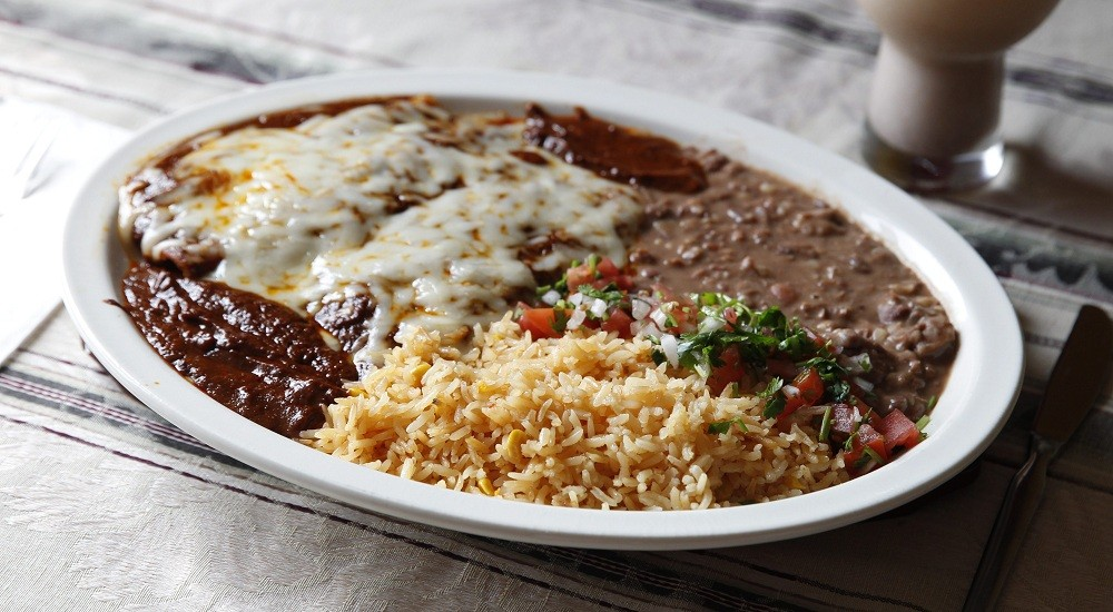 Enchiladas made with the classic mole, accompanied by refried beans and rice are available at the newly opened Valle of Mexico II. (Sharon Cantillon/Buffalo News file photo)