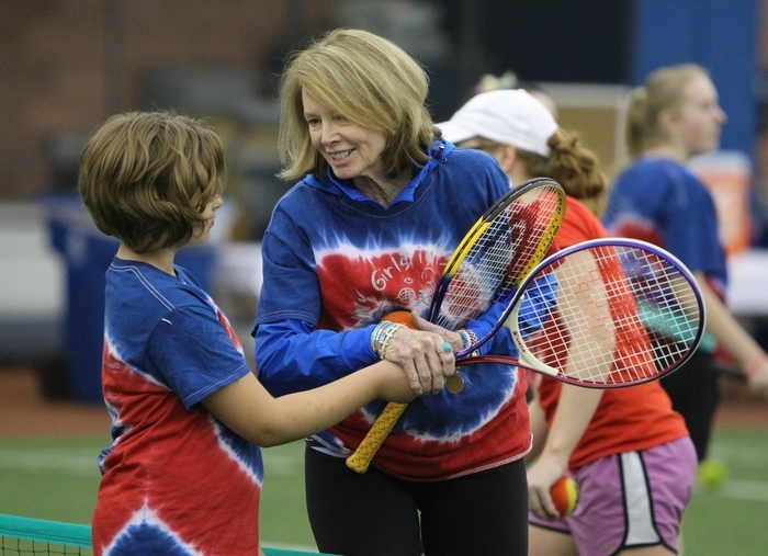 Mary Wilson works with girls from city schools during the semi-annual Western New York Girls in Sports Clinic on Saturday at the Buffalo Bills' field house in Orchard Park. (Mark Mulville/Buffalo News)