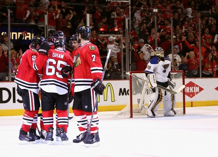 Members of the Blackhawks celebrate Duncan Keith's third-period goal against Ryan Miller and the Blues. (Getty Images)