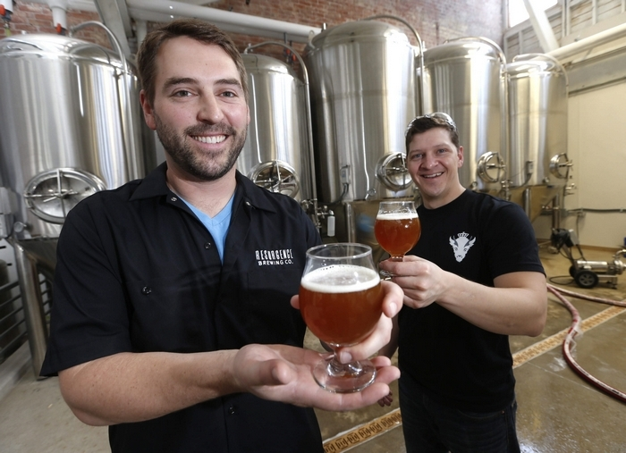 Owner Jeff Ware, left, and Dave Collins, master brewer, sample a fresh batch of IPA at Resurgence Brewing Co. (Photos by Robert Kirkham/Buffalo News)