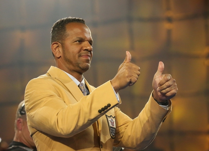 Andre Reed gives the thumbs-up after being presented with his Hall of Fame jacket Friday in Canton, Ohio. (James P. McCoy/Buffalo News)
