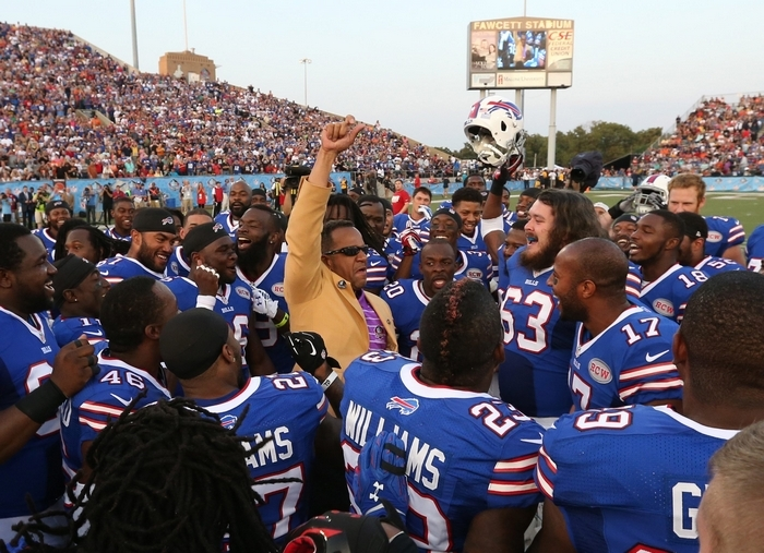 Bills players surround new Hall of Famer Andre Reed before the start of Sunday night's 17-13 preseason loss to the New York Giants. (James P. McCoy/Buffalo News)