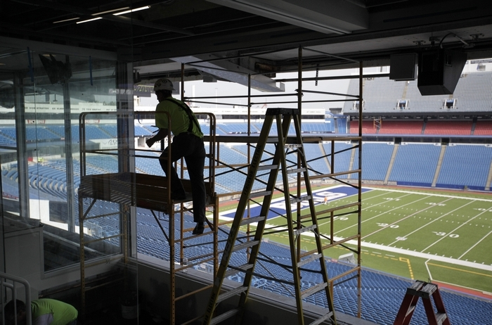 A worker climbs scaffolding while working in the new broadcast booth at Ralph Wilson Stadium, Monday, Aug. 11, 2014.  (Derek Gee/Buffalo News)