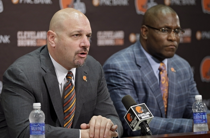 Cleveland Browns head coach Mike Pettine, left, with general manager Ray Farmer, came over from the Bills after one year as Buffalo's defensive coordinator. (Associated Press)