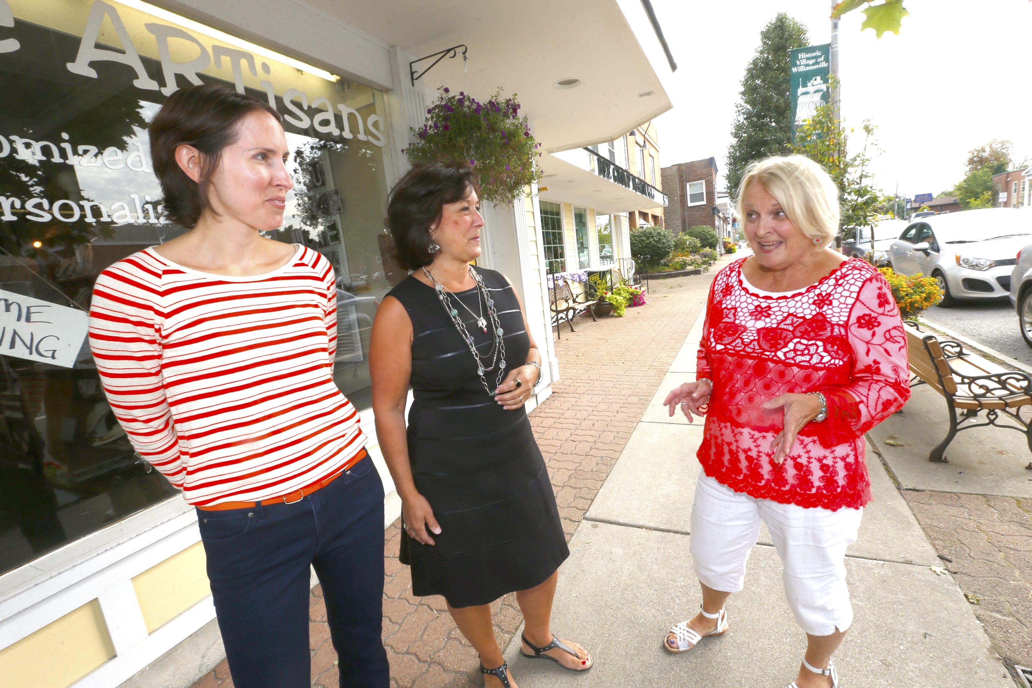 Village of Williamsville residents from left, Deb Rogers, Debbie Steinbruckner and Bea Slick, wouldn't trade village living for anything.  They were on Main St. on Friday, Aug. 29, 2014.  (Robert Kirkham/Buffalo News)