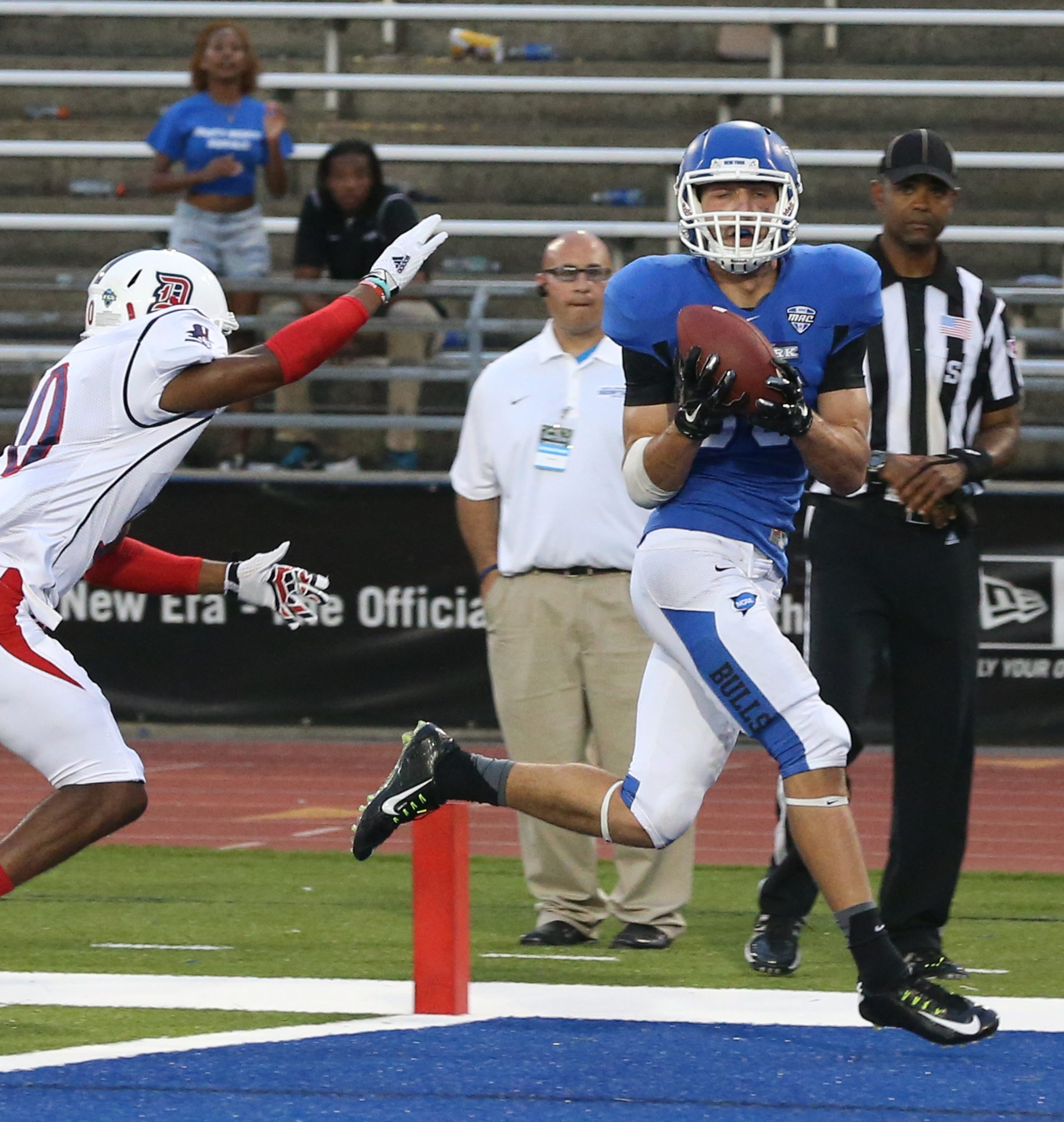 UB receiver Ron Willoughby catches the game-winning touchdown over Duquesne defensive back Malik Shegog (10) in the fourth quarter.