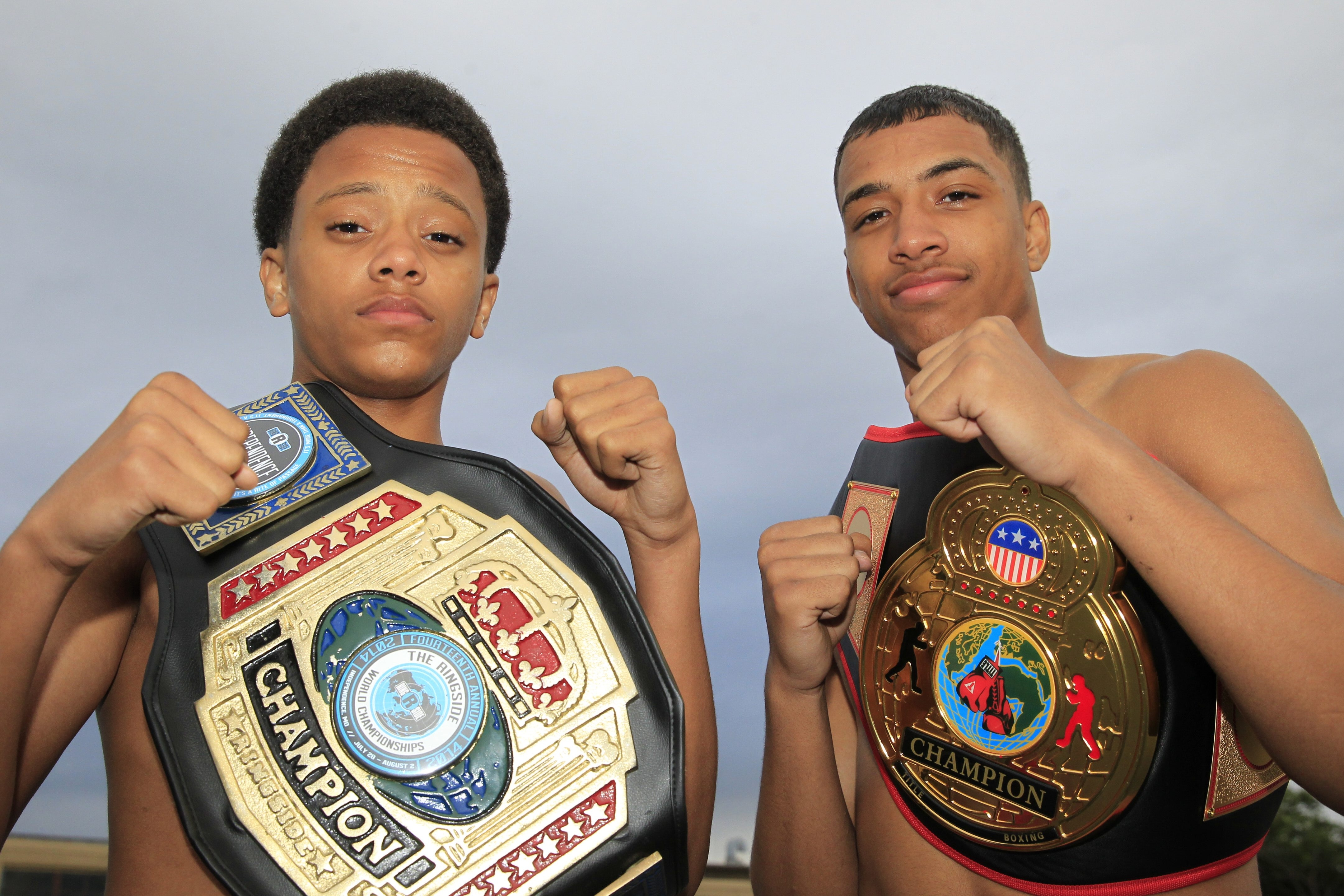 Destyn Hopkins, left, and his brother Trevon bus from Niagara Falls to Buffalo six times a week to train with their father.