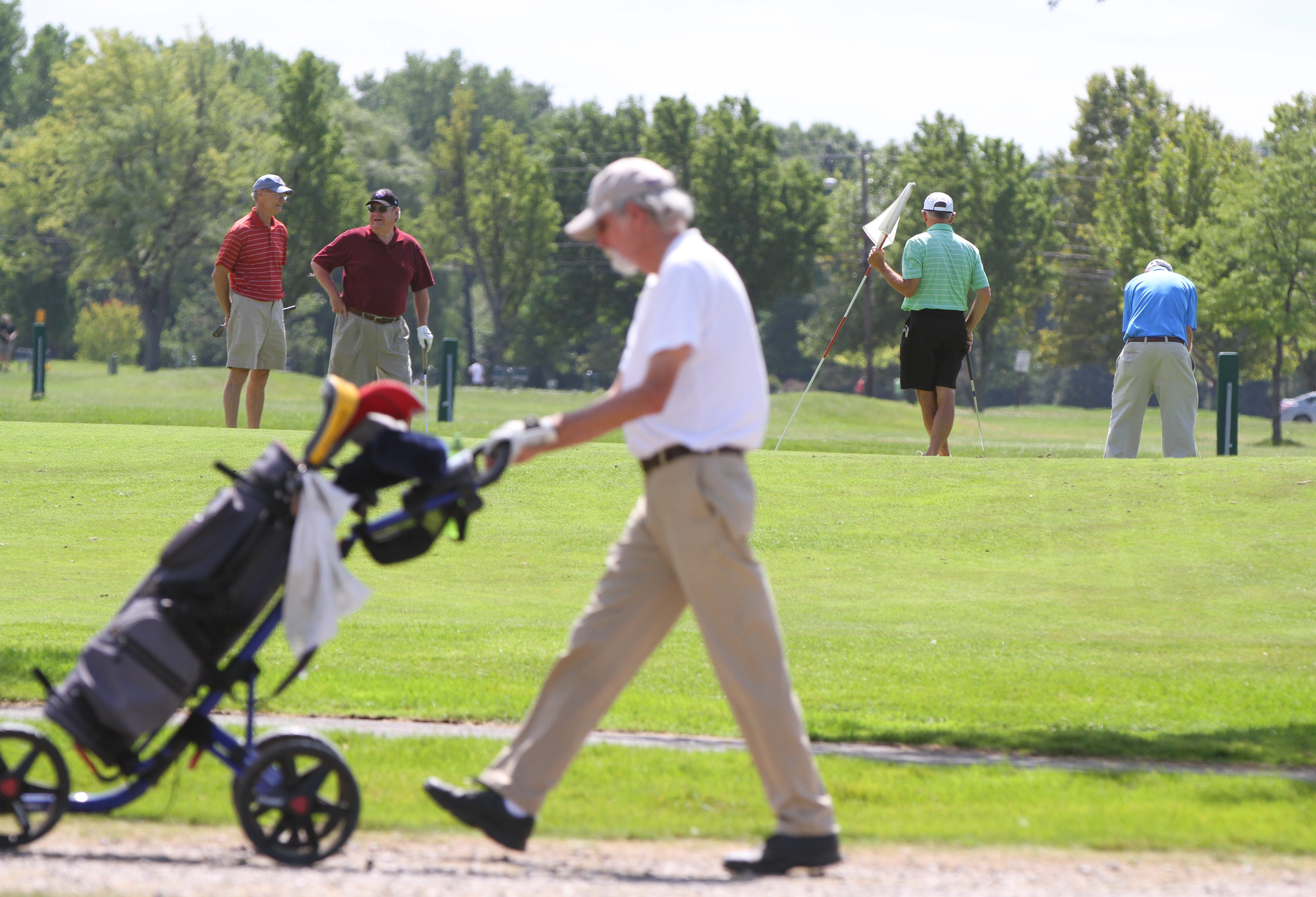 Golfers play at Audubon Golf Course in Amherst. The town is losing money on its three golf courses and is considering turning them over to private operators.