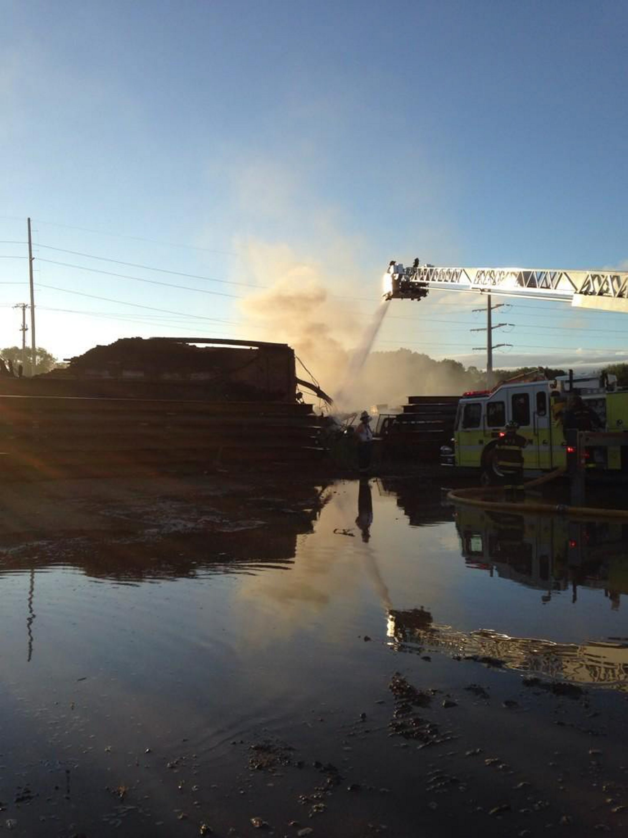A blaze at a warehouse in Blasdell brought 70 firefighters to the scene. Crews this morning work at the scene. (Lisa Khoury)
