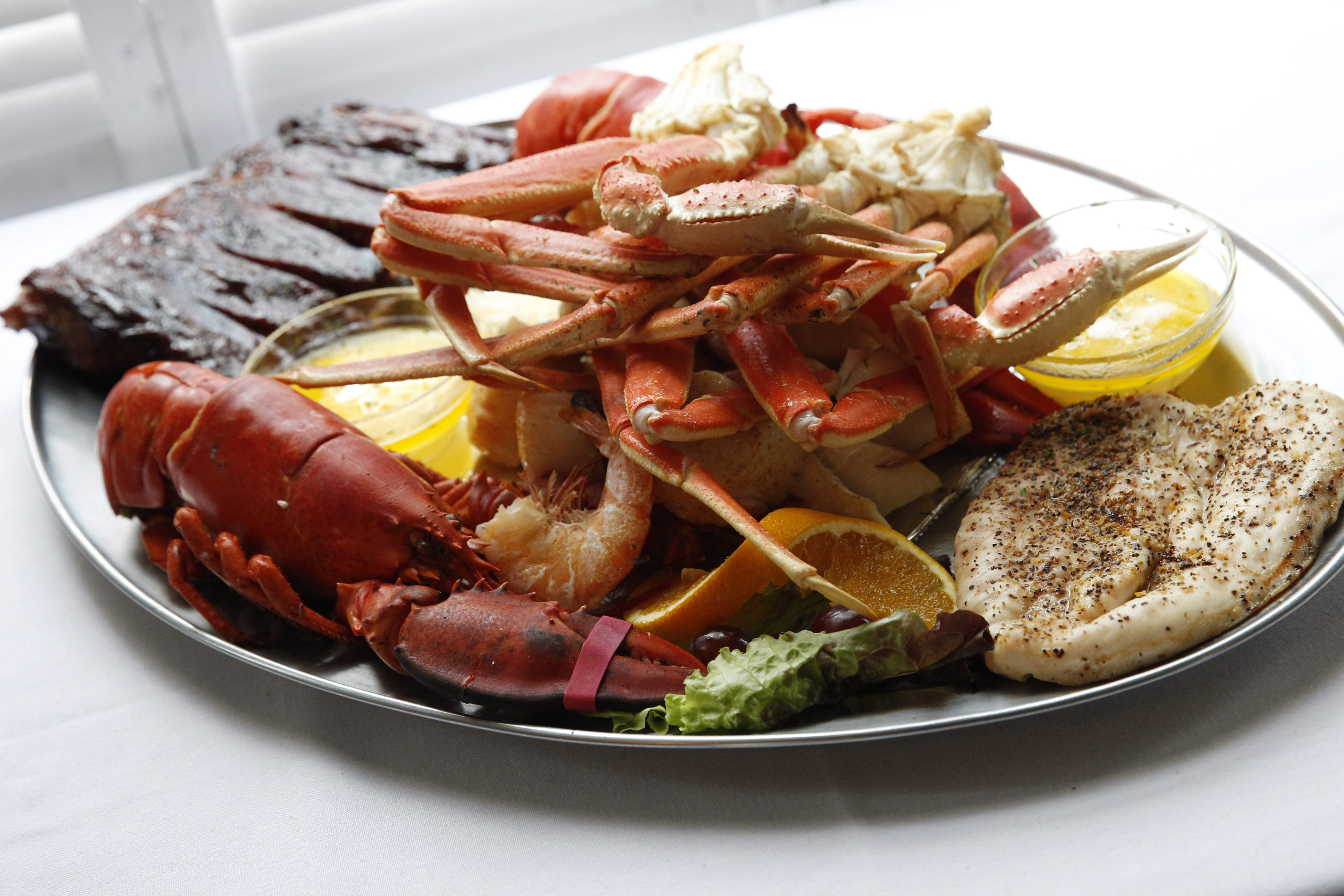Two lobsters, six jumbo shrimp, six sea scallops, three clusters of snow crab, broiled haddock, a half-rack BBQ ribs and a chicken breast.