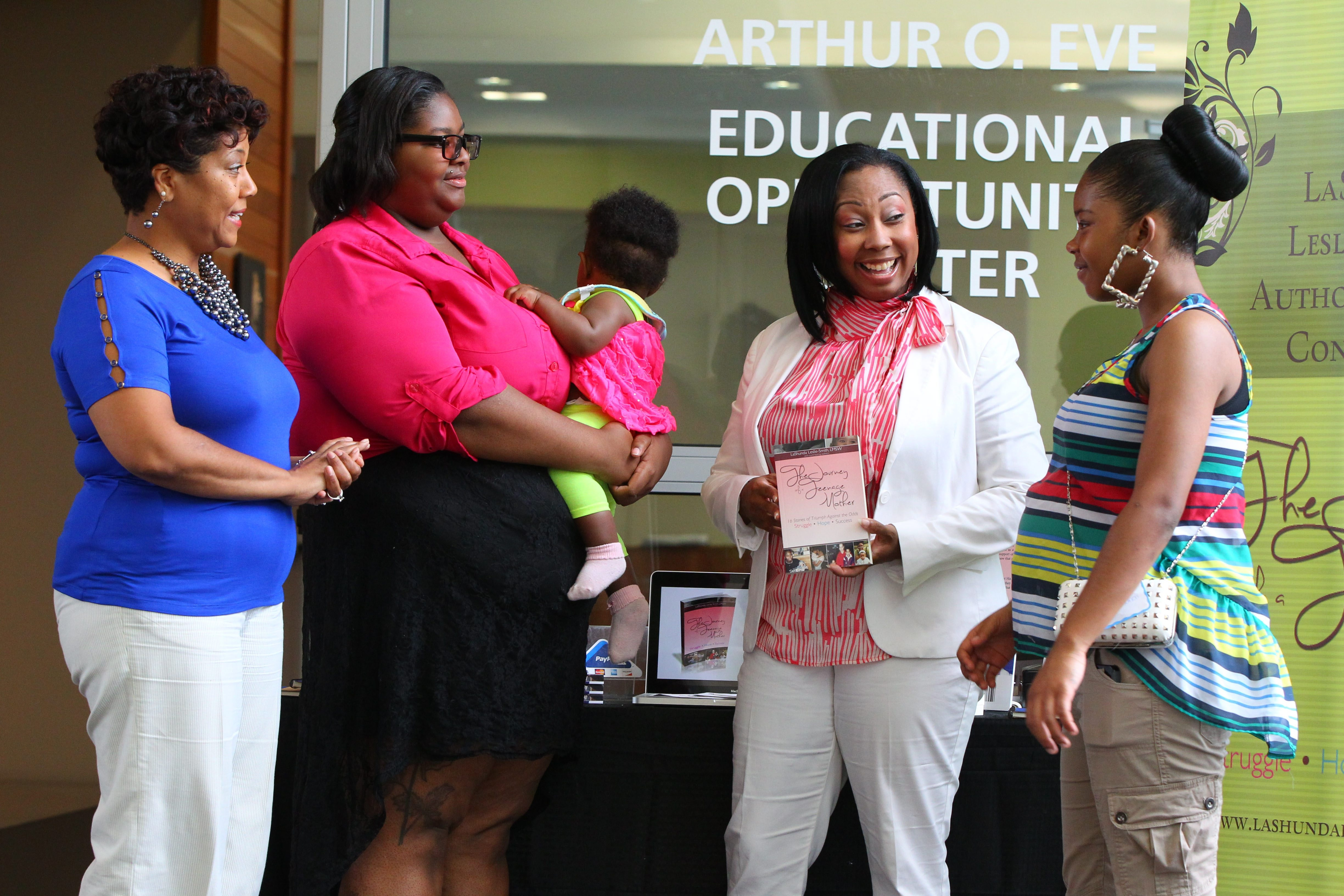 From left, Janice White, executive director of True Community Development Corp.; Kiari Walker and her daughter Kaimaris Long; LaShunda Leslie-Smith, educator, author and motivational speaker; and LaDomanai Wiggins attend the second annual Young Parents Campus reception and awards Saturday at the Arthur O. Eve Educational Opportunity Center on Ellicott Street.