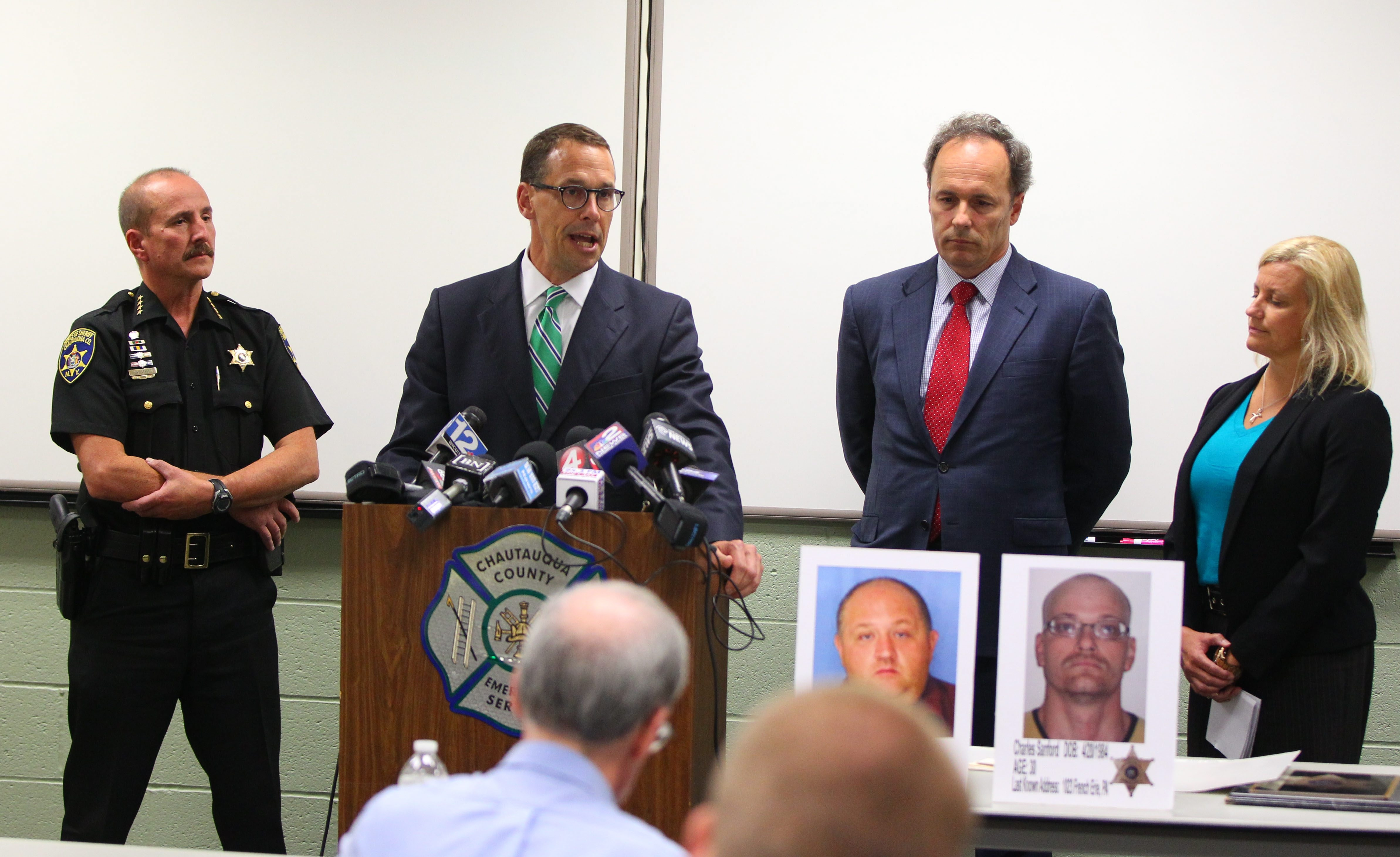 Chautauqua County Sheriff Joe Gerace, left, speaks at Friday's news conference as Chautauqua County District Attorney David Foley, second right; U.S. Attorney William Hochul Jr., second left; and Holley Hubert of the Buffalo office of the FBI, right, listen.