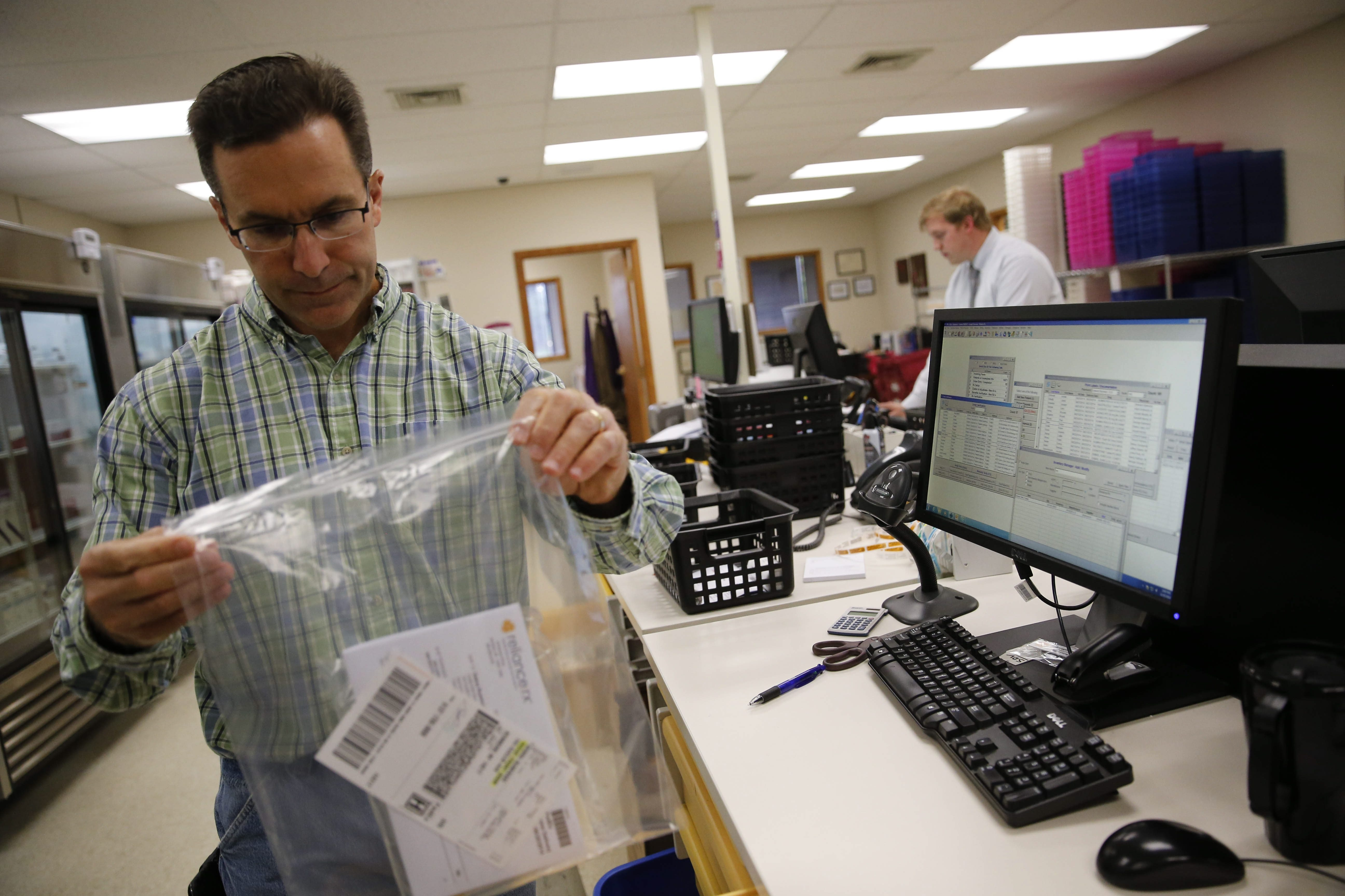 Pharmacist Joe Surowiec fills a prescription in the pharmacy at RelianceRx in Amherst on Wednesday.