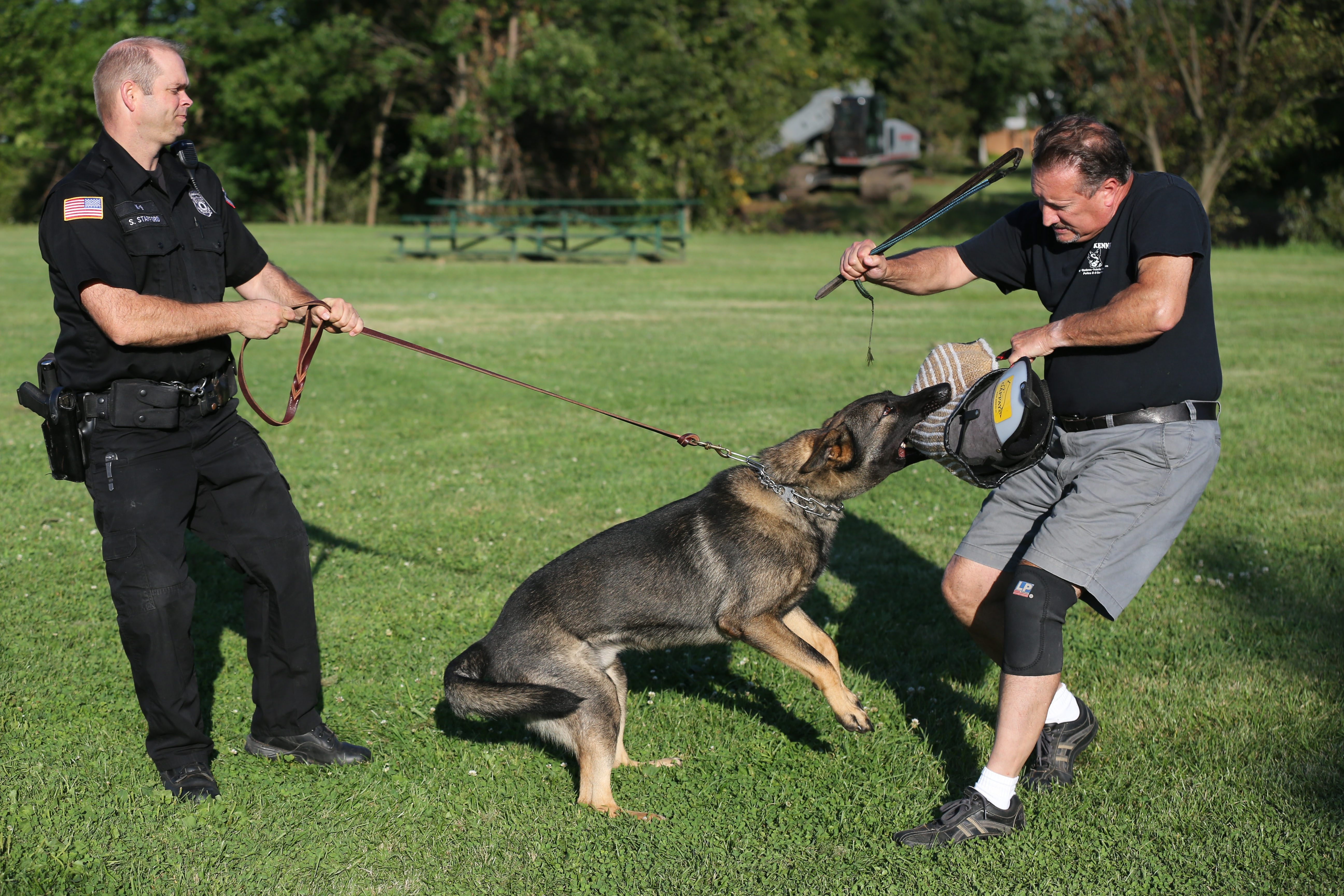 Lewiston Police Officer Scott Stafford with Gray, a newly acquired German shepherd police dog, during training at St. Leo the Great School in Amherst with Dave Lepsch, of Ceska Kennel, right.