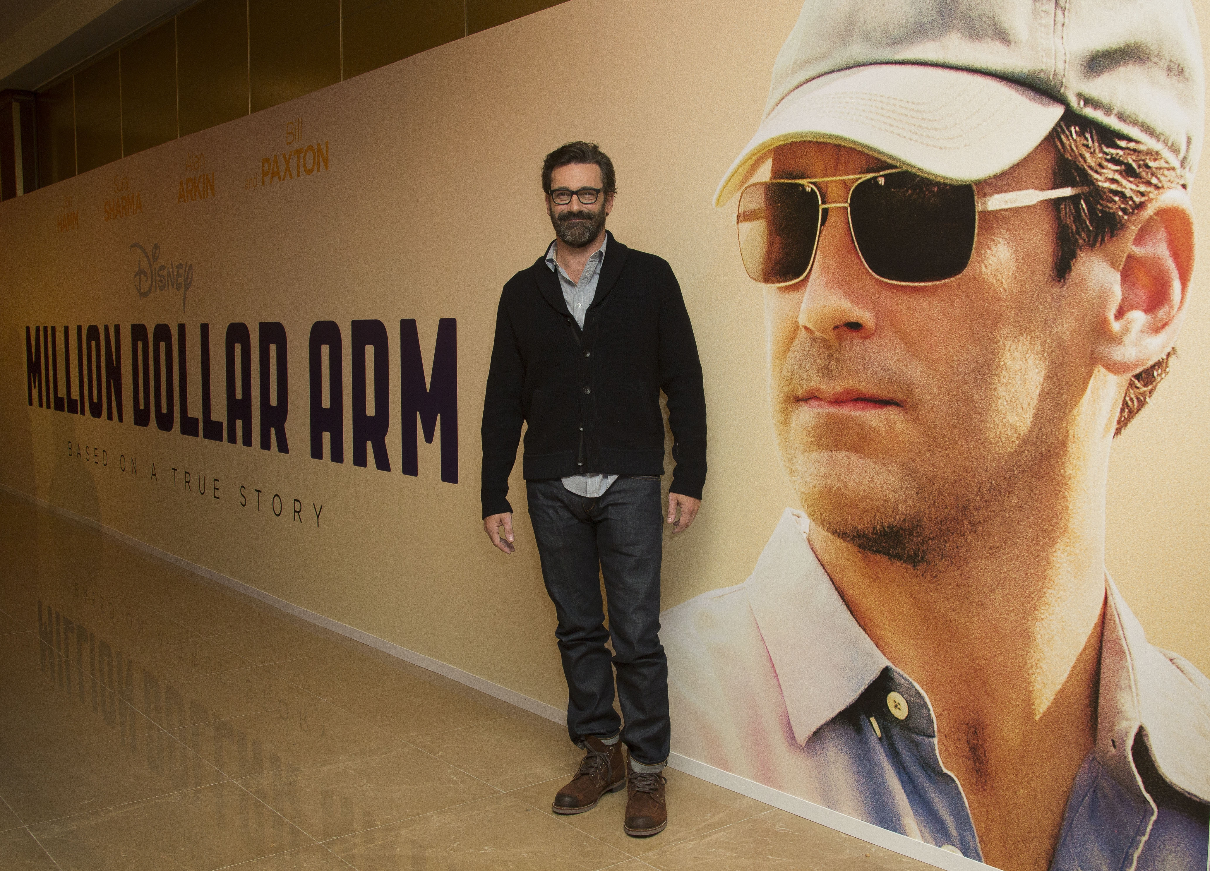 "Actor Jon Hamm, a St. Louis native shown at a screening of ""Million Dollar Arm"" in London on Thursday, says he  supports the protests in Ferguson, Mo."